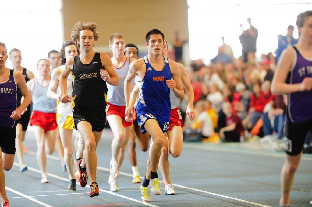 Auburn Jimenez '14 races during the men's 3000-meter event at the St. John's Alumni meet. Jiminez finished with a 9:09.22 in second place, behind a St. John's alum. Jiminez's time qualified him to compete in the premier University of Minnesota Snowshoe Open Meet, an event featuring the top area runners from Division I, II and III. Photo Credit: Christopher Mitchell / SportShotPhoto.com.
