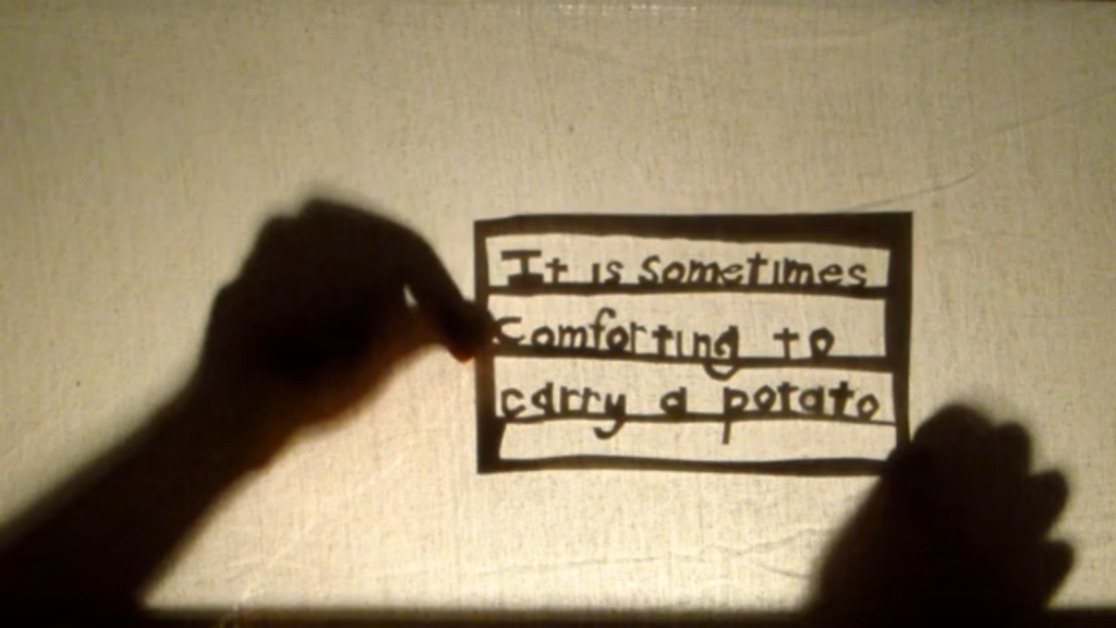 "Stills taken from Geil-Neufeld's shadow puppet show called ""It is sometimes very comforting to carry a potato (and other truths about growing up)."" Courtesy of hannahgeilneufeld.com"