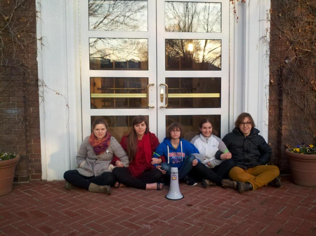 Rebecca Hornstein '13, Leewana Thomas' 14, Hannah Siegel '16, Arianna Feldman '16, and Alex Bartiromo '16 block the east entrance to Weyerhaeuser Hall on Thursday morning. Photo Credit: Emma Kalish '13