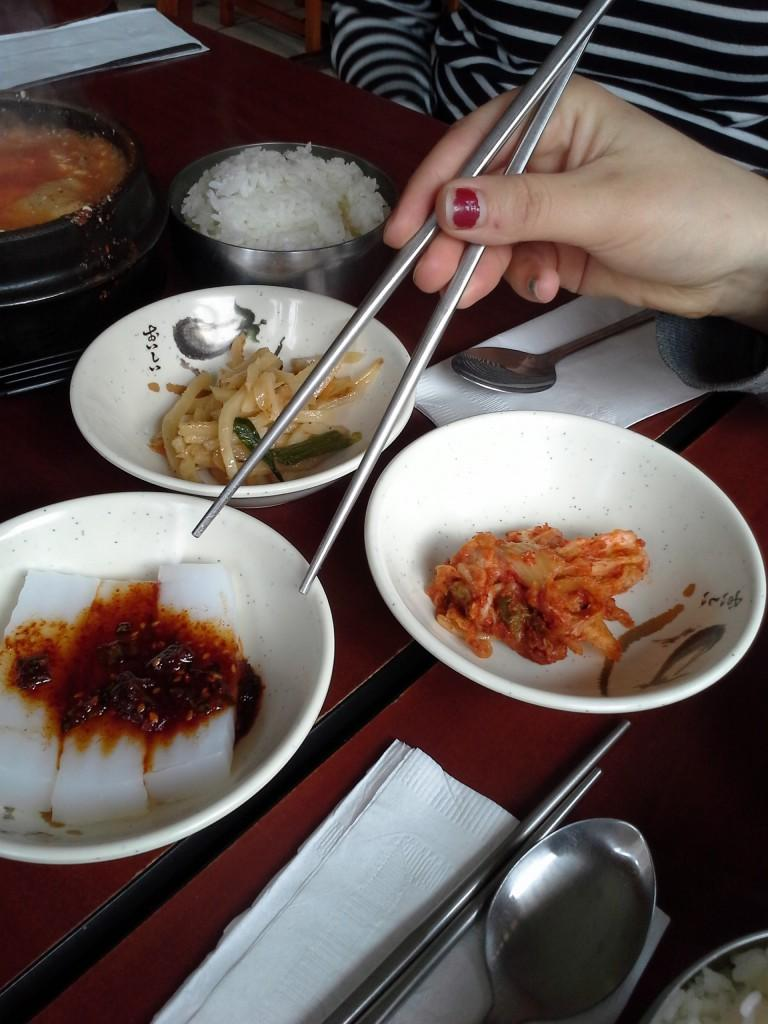 Camillle+Cauchois+%E2%80%9913+digs+into+the+side+dishes+accompanying+the+soondobu+jigae+at+Kimchi+Tofu+House.+