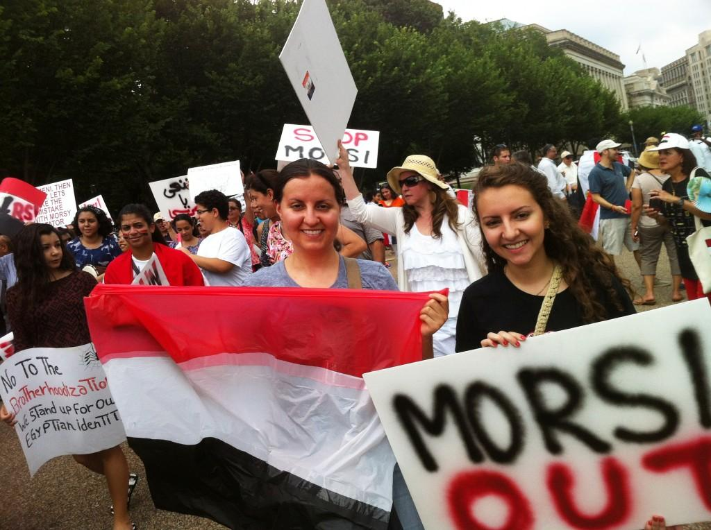 Emily TahaBurt '16, to the right, attending an Anti-Morsi protest in Washington DC. TahaBurt spent the first nine years of her life in Egypt, and almost all of her family still lives in the Giza area. Photo courtesy of Emily TahaBurt.