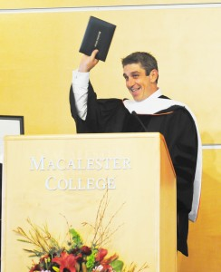 Convocation speaker Richard Blanco holds up his new honorary degree from Macalester for all to see. Blanco spoke to a crowded Kagin this week on the topics of national and personality identity, including readings from his original works. Photo by Alex Bentz '14.