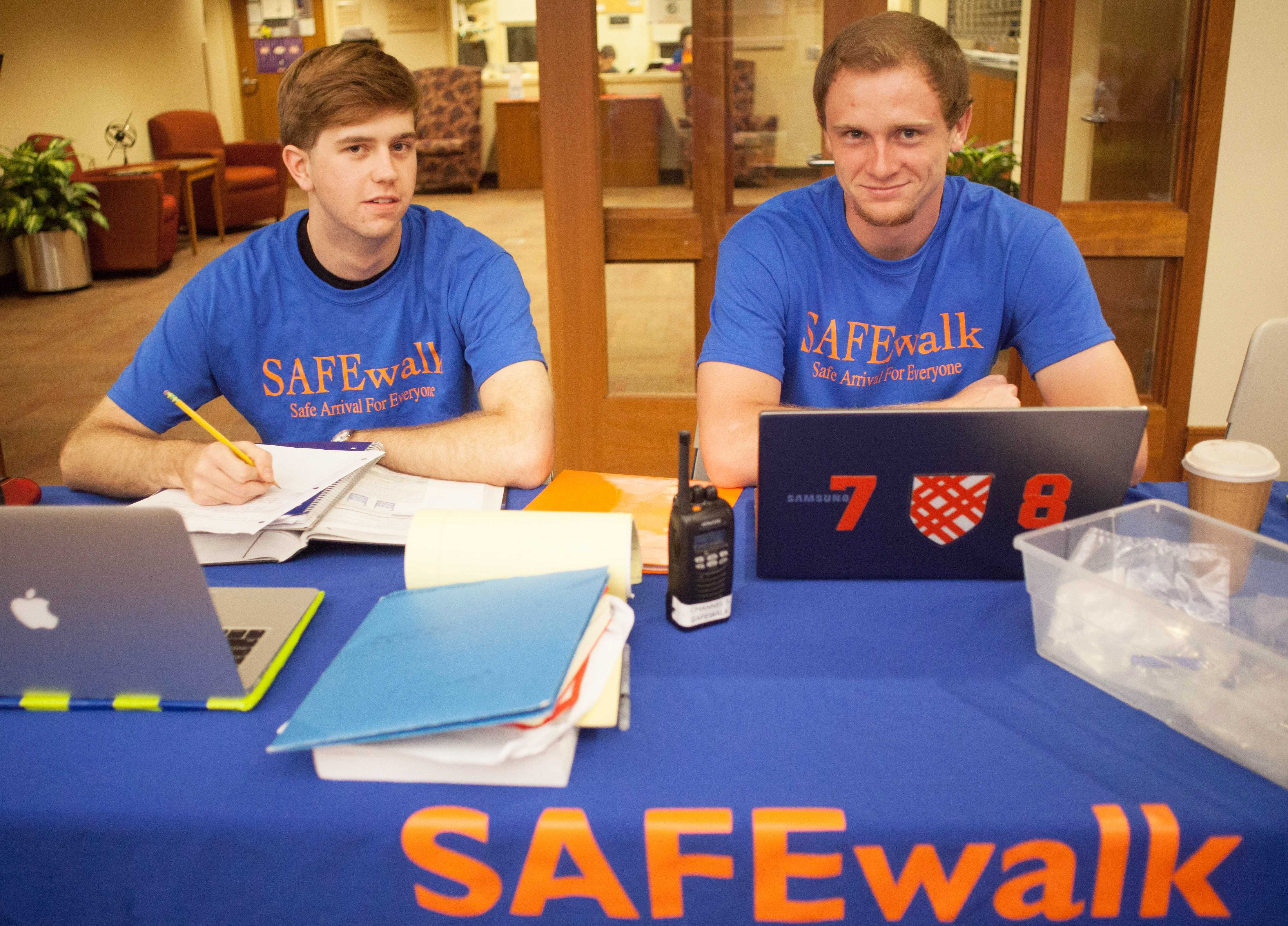 SAFEwalkers [left to right] Alex Coppins '15 and Bradley Cox '16 sit at the SAFEwalk desk located on the top floor of the Campus Center. SAFEwalkers are available from 9 p.m. to 1 a.m. daily to walk students to and from campus.