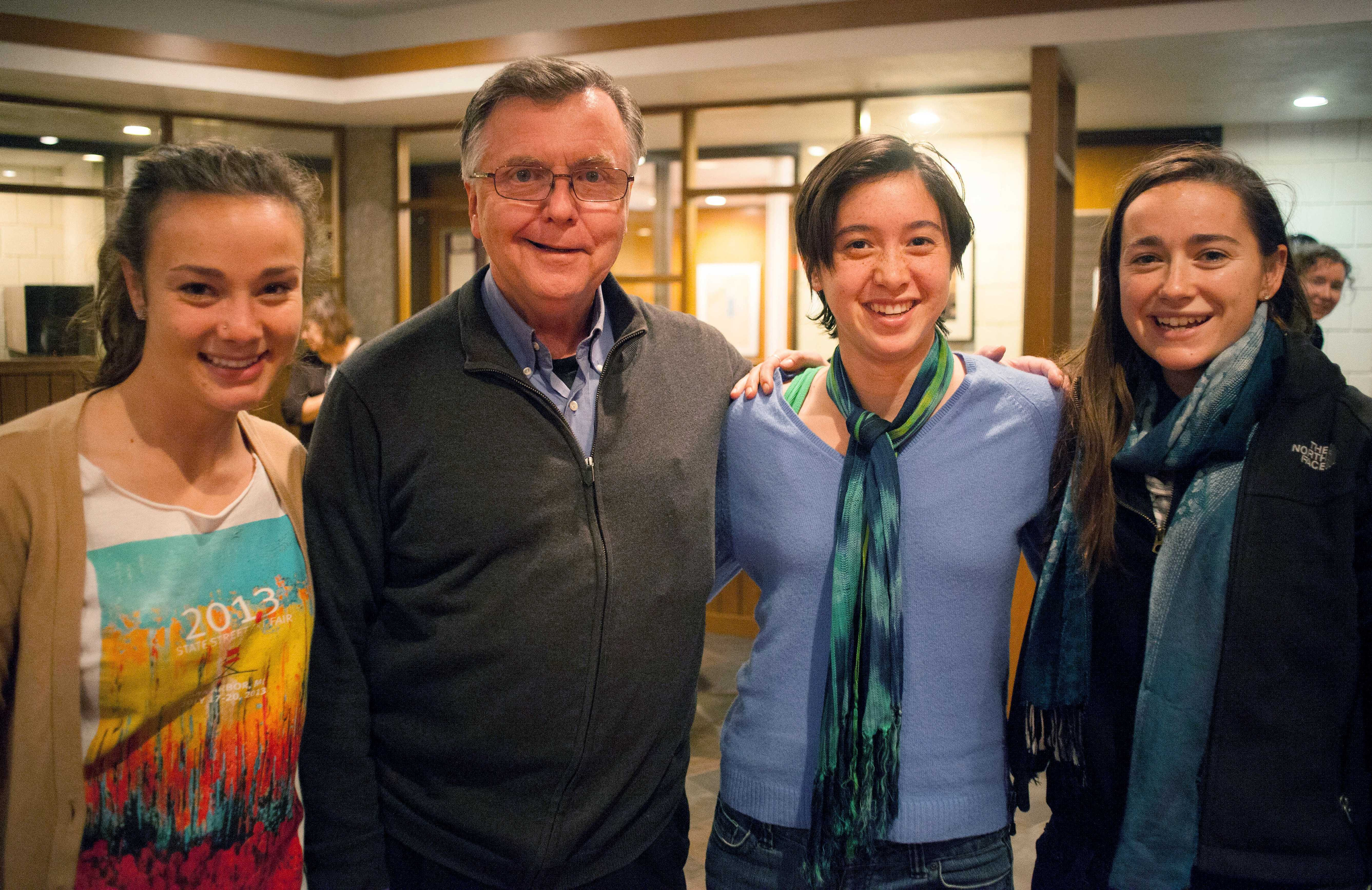 From left: Caroline Wright '16, Fr. Bob O'Donnell, CSP, Caitlin Toner '15, and Ellen Brady '15 at a farewell reception for O'Donnell, held Tuesday in the CRSL. O'Donnell was reassigned over the summer.
