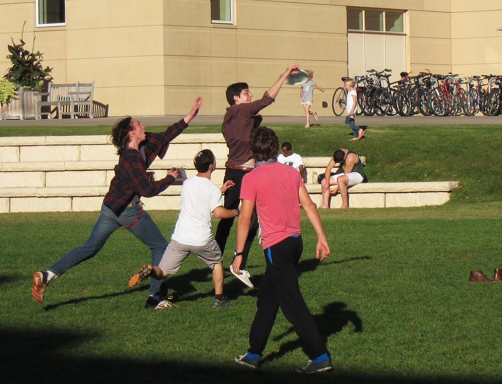 Tom Wakin '16 jumps for the disc during last week's Blue Monkey practice. Photo by Naomi Guttman '16