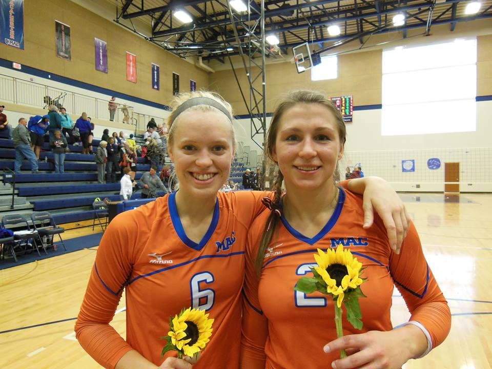 Bailey+Rehnberg+%E2%80%9914+%28left%29+and+Laura+Avena+%E2%80%9914+%28right%29+were+recognized+on+Senior+Night+for+their+four+years+of+commitment+to+the+program.+Photo+courtesy+of+Macalester+College+Volleyball.+