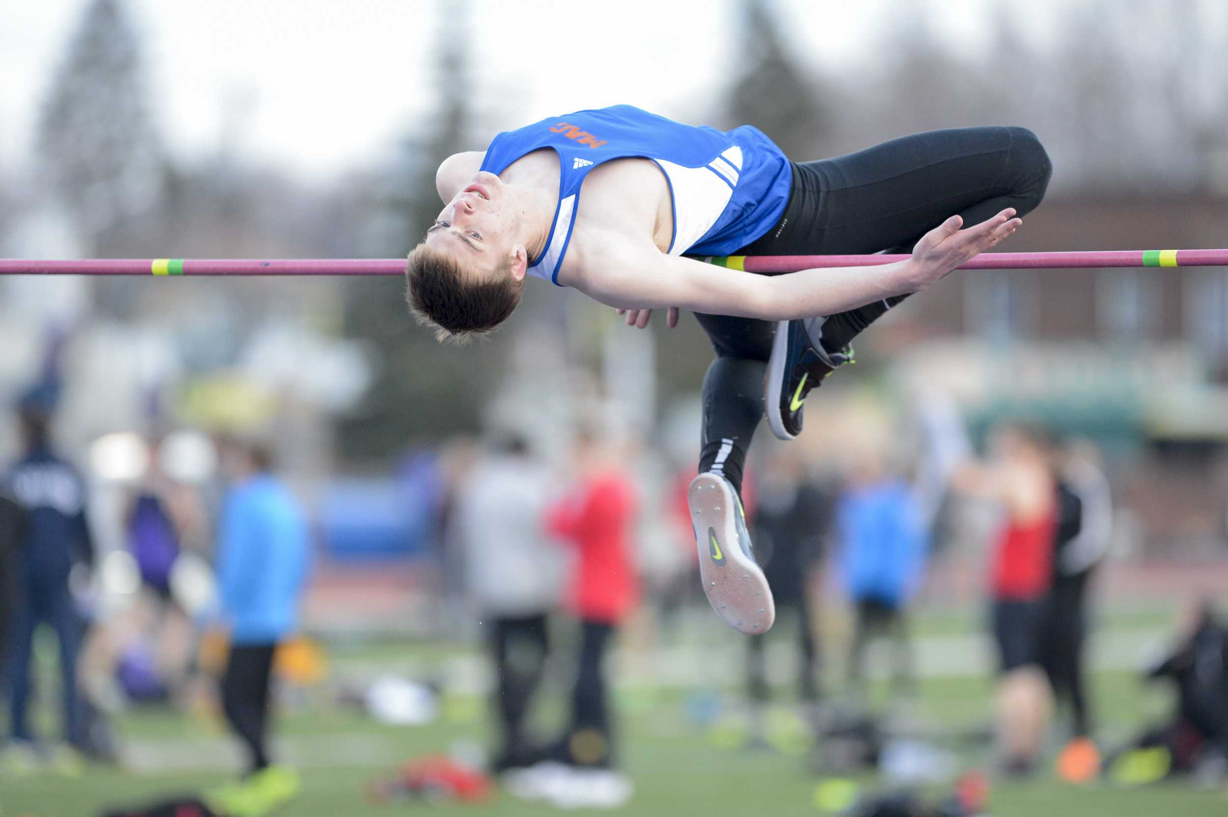 Logan Hovie '16 jumps at the Twilight Meet last April at Macalester. Hovie qualified for the Division III National Track and Field Championship, where he finished 19th in the high jump. Photos courtesy of Christopher Mitchell.