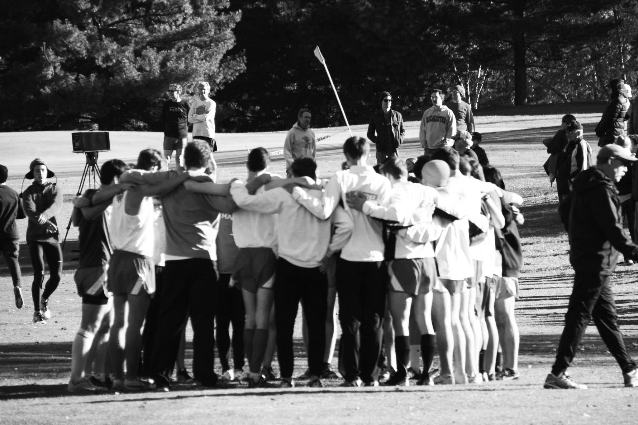 The Men's Cross Country team huddles before competing in the MIAC Championships at Como Park in Saint Paul. The team finished sixth out of 11 in the conference. Photo courtesy of Steve Gilfix.