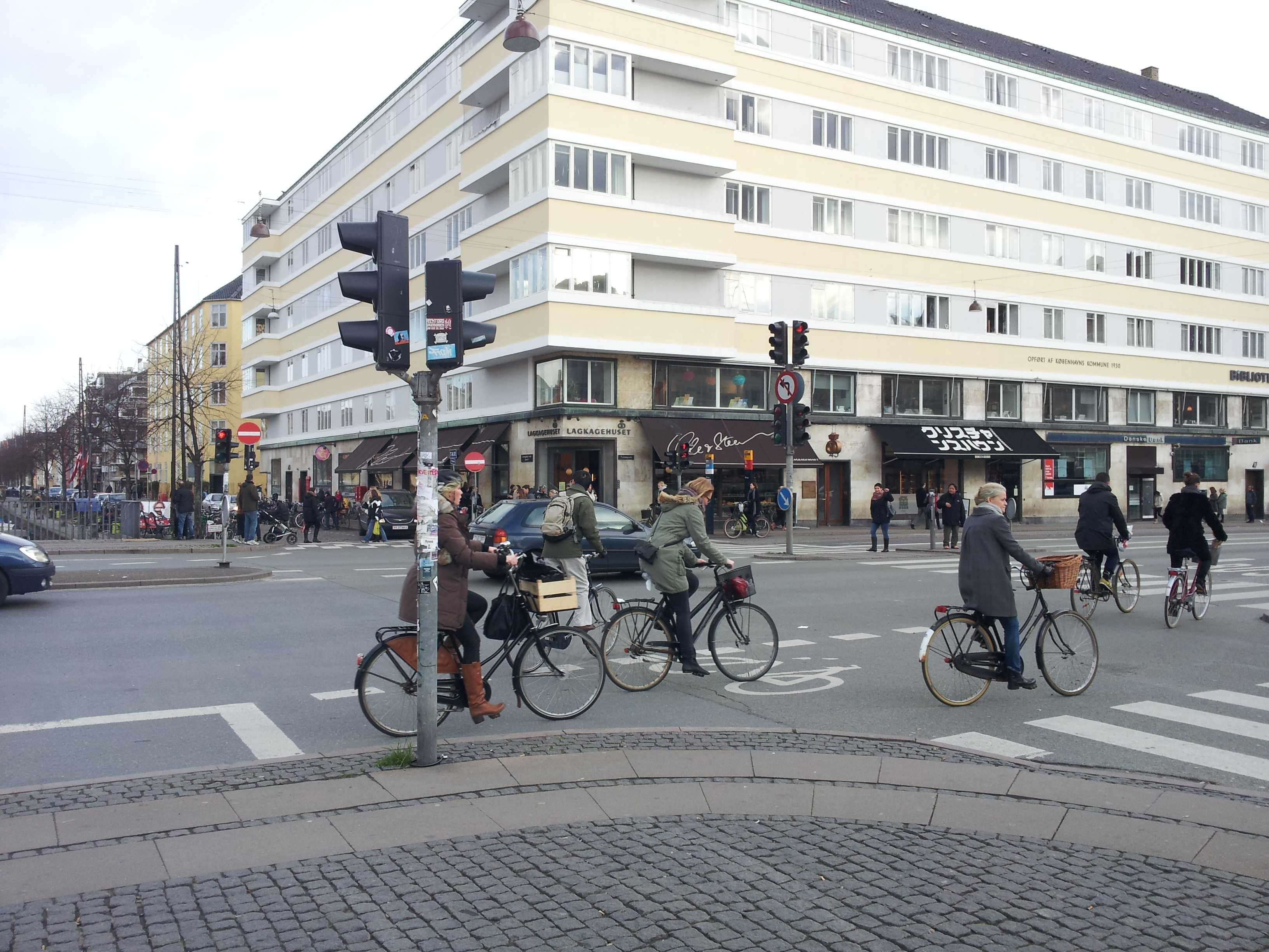 Cyclists in Copenhagen enjoy the vitality of the city, riding in designated bike lanes that benefit from head-starts at traffic signals and higher grades than the rest of the street. Photo by Joe Huber '15.