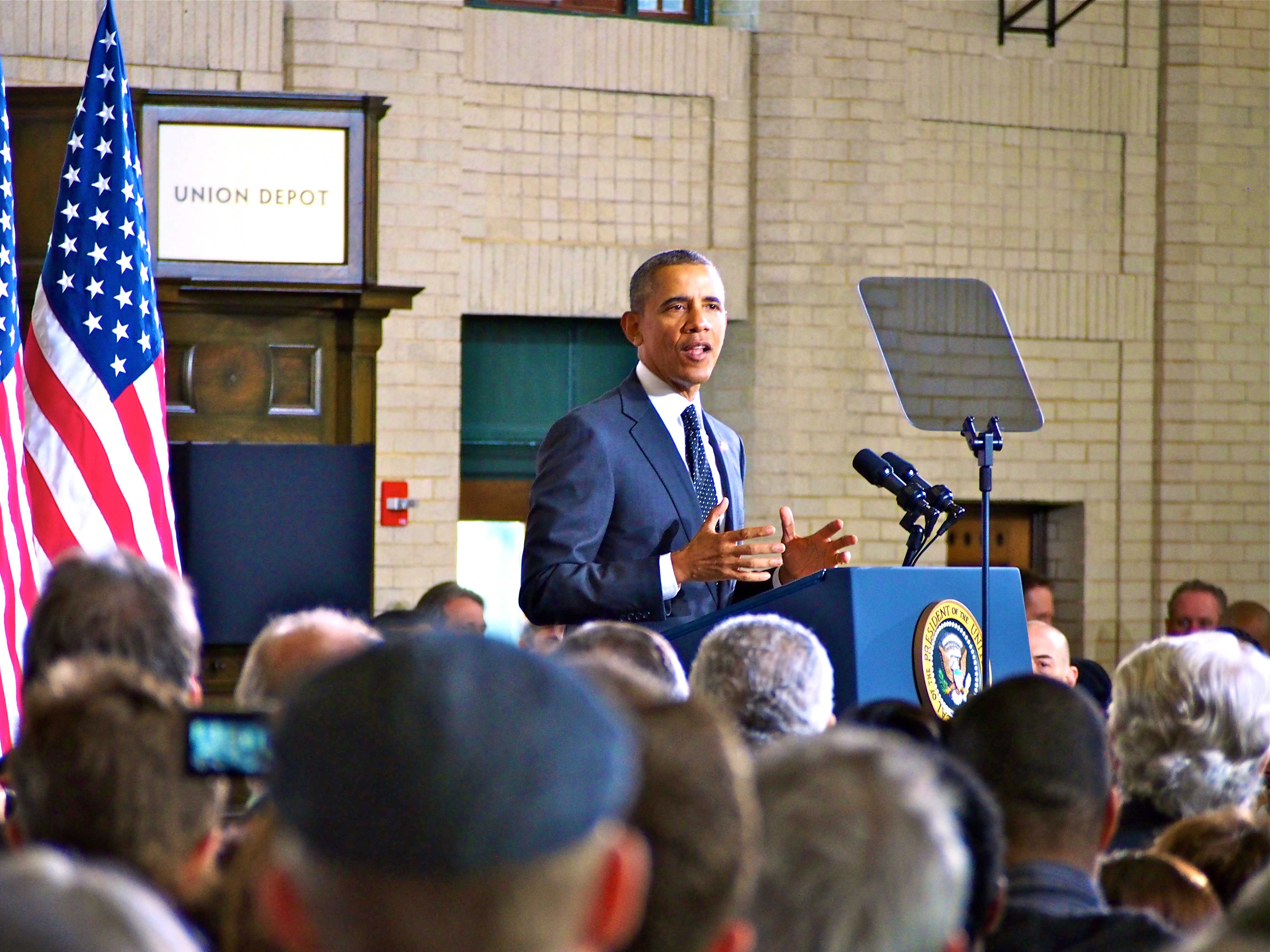 President Barack Obama speaking to a crowded Union Depot on Wednesday, Feb. 26. Roughly 1,300 were in attendance and heard the president's announcement of competitive federal grants for infrastructure development in cities around the United States. Photo by Jesse Meisenhelter