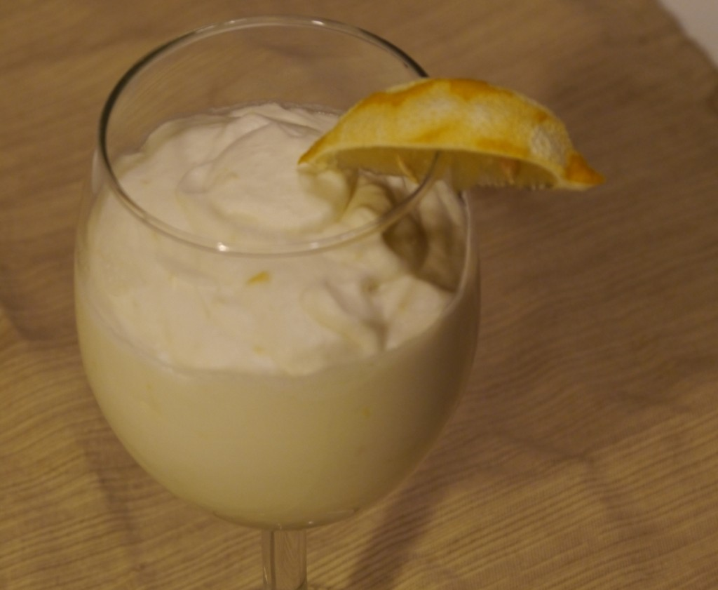 A+homemade+everlasting+syllabub+with+lemon+wedge+garnish.++The+drink+looks+a+lot+like+a+meringue+and+moves+like+plastic+until+stirred.+Photo+by+Jeff+Kaplan.
