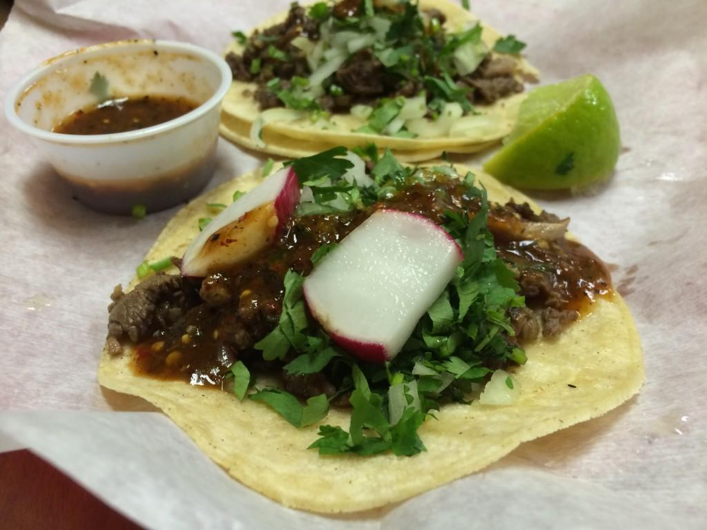 Two+tacos+from+Taco+Taxi%2C+served+with+salsa+and+radishes.+