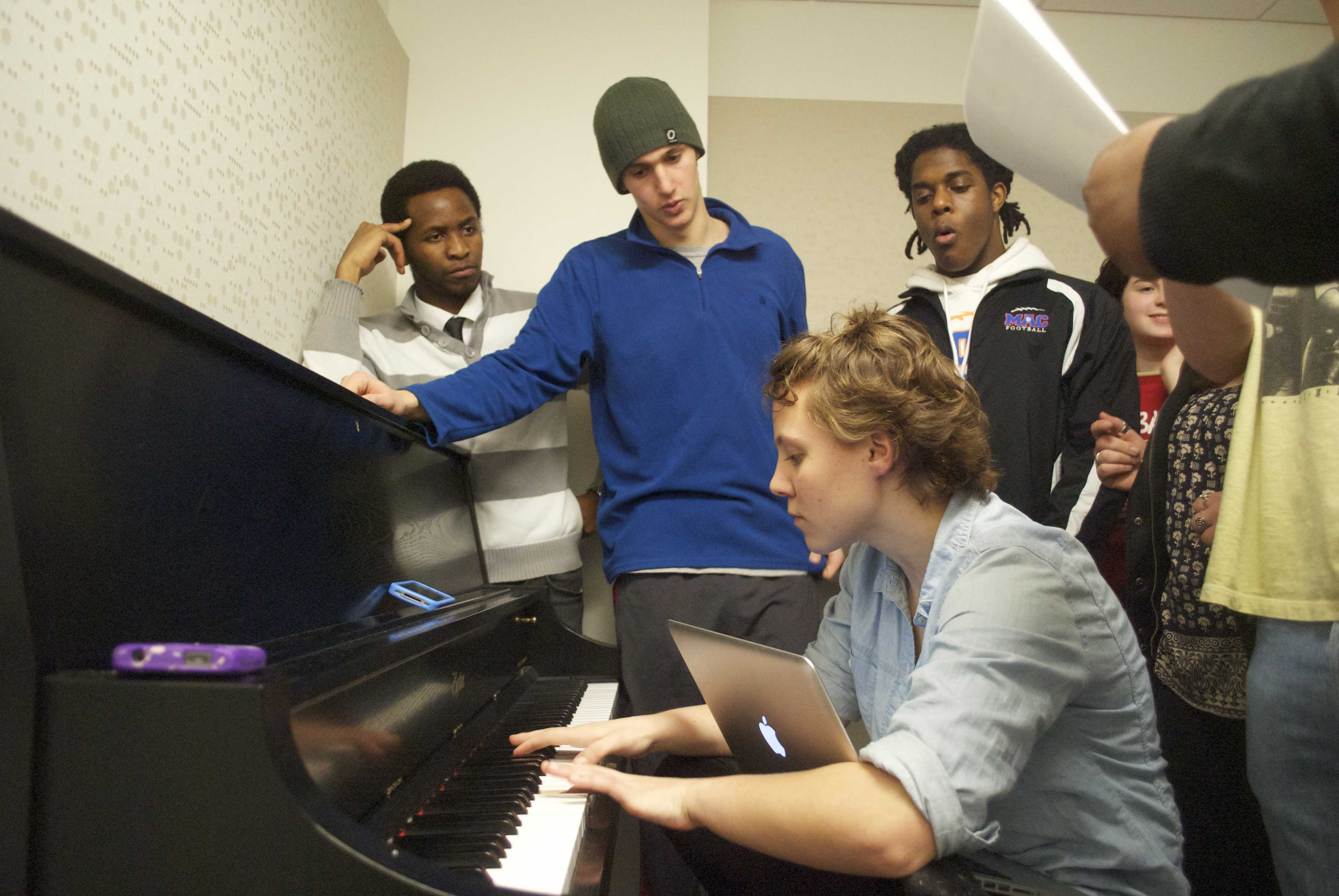 Chromactics members Peace Madimutsa, Ben Haltmaier and Hannah Field work on their R&B arrangements. The Chromactics are Macalester's fifth a cappella organization, and formed earlier this year. Photo by Joe Bermas-Dawes '17.