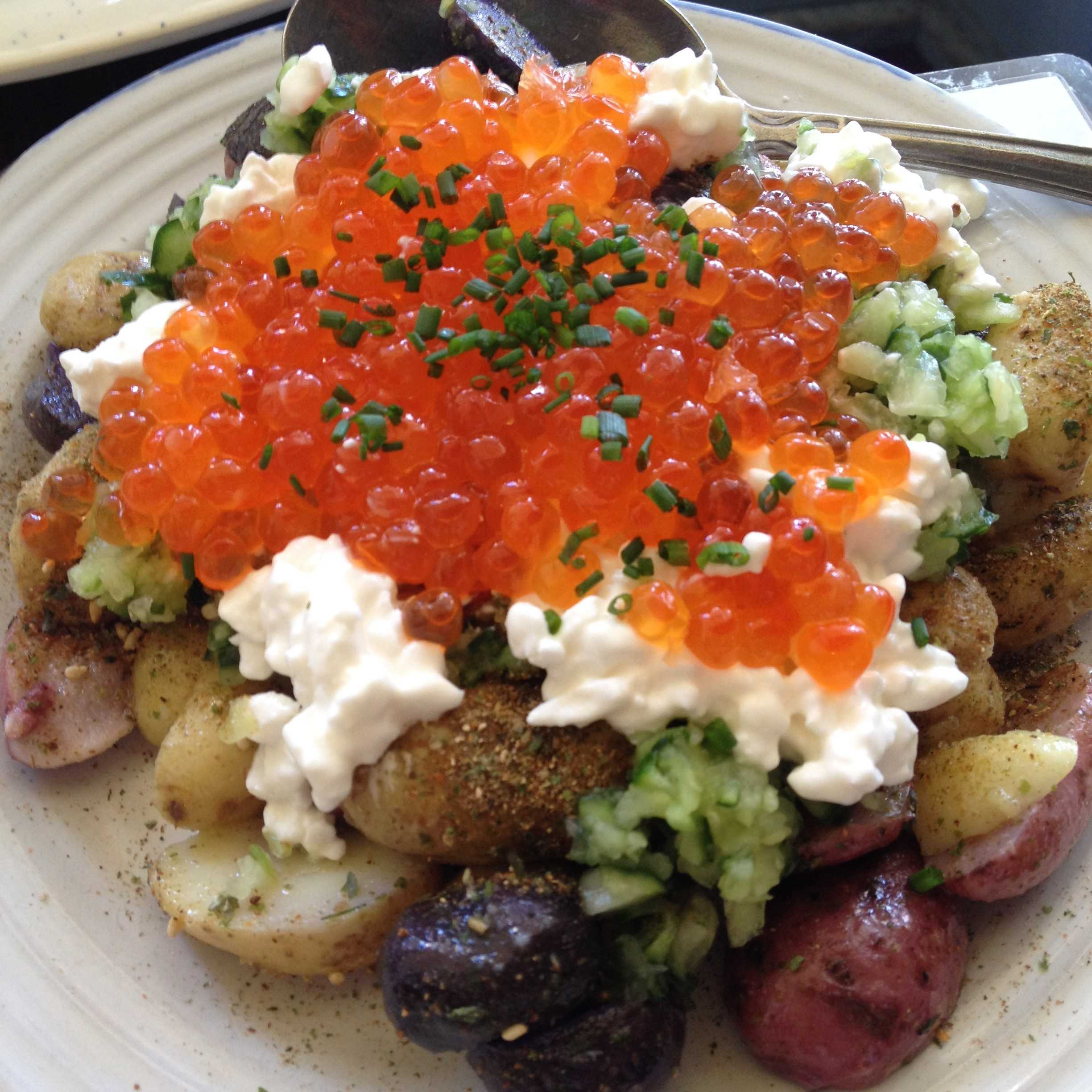 Dishes from Mission Chinese Food in San Francisco. Salmon roe on a bed of fried potatoes. Photo by Kaila Chan '14