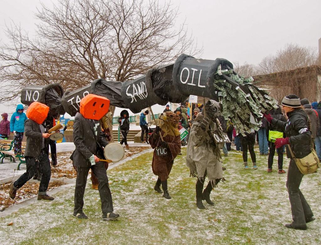 Approximately 75 Macalester students participated in the April 3 protest against the pipeline. Students worked with climate change organization Minnesota 350 and MPIRG to organize the protests. Costumes for the lead protesters were provided by the Heart of the Beast Theater. Photo by Jesse Meisenhelter '16