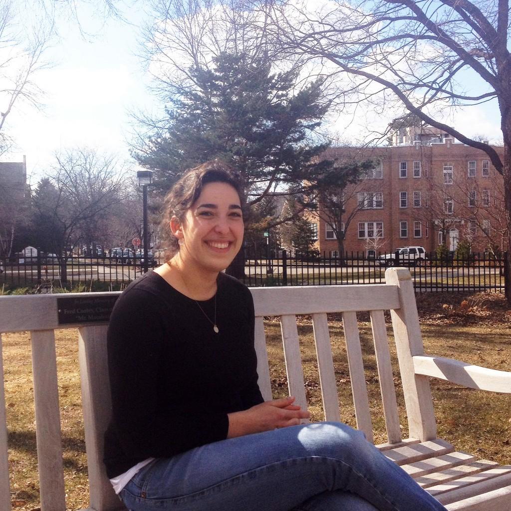 Nina Slesinger '14 enjoys the beautiful weather. Photo by David Lopez '14