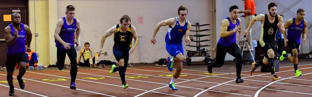 Macalester's Track team won five events over the weekend to finish in second place at St. Olaf's Tostrud Classic. Jack Schultenover '18 (center) finished in first place at the preliminary 60-meter dash, with a time of 7.15 seconds, to finish in second at the final heat. Other victories came from Joe Giamberdino '15 in the 3000-meter run, Trevor Maggart '16 in the 5000-meter run, the 4x200 relay (of Konnor Fleming '15, Tre Nowaczynski '17, Bolton Howes '15 and Jole Miller '15), and Miles-Keys McKay '18 in the triple jump. The Scots will host the Kilt Classic this weekend in the Fieldhouse, their final meet before the MIAC championships. Photo by Anders Voss '17.