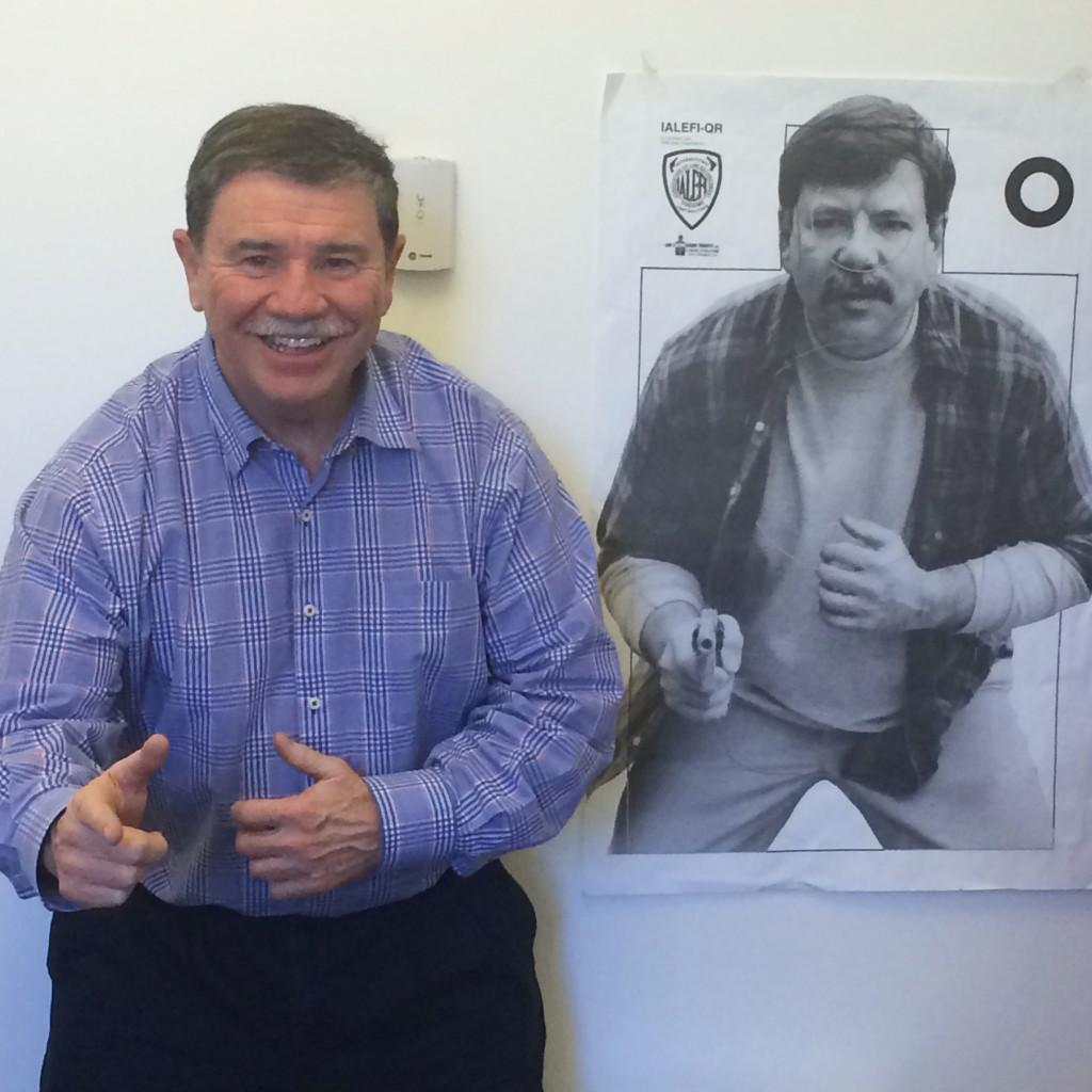 Terry Gorman's office is filled with memorabilia, including this poster, which the St. Paul Police Department uses for target practice. Gorman says he is often stopped on the street by police officers who recognize him from the poster. Photo by Steph Shimota '17.