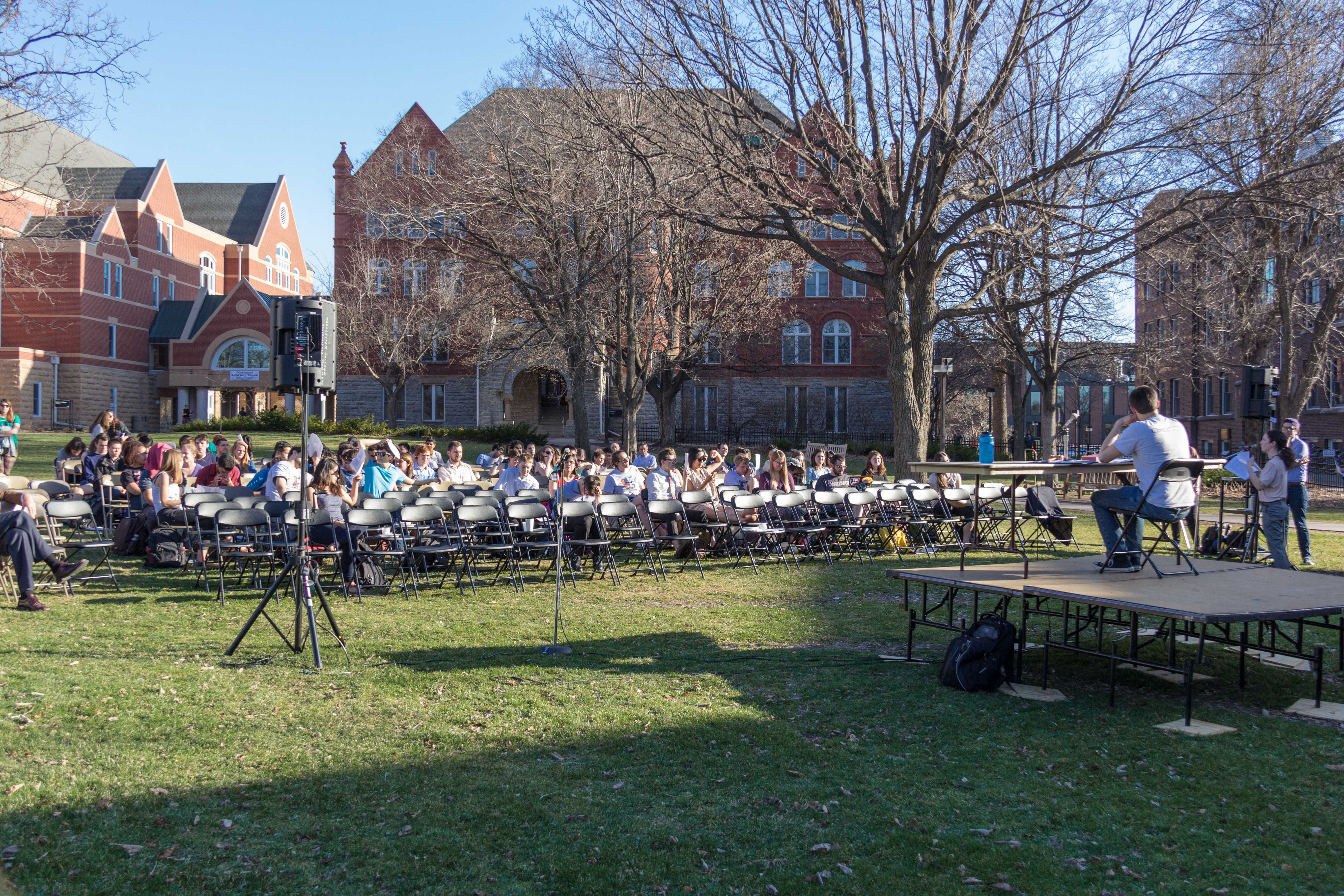 Students gathered on Old Main Lawn on Tuesday evening to debate a resolution on income inequality at Mac. Photo by Josh Koh '18.
