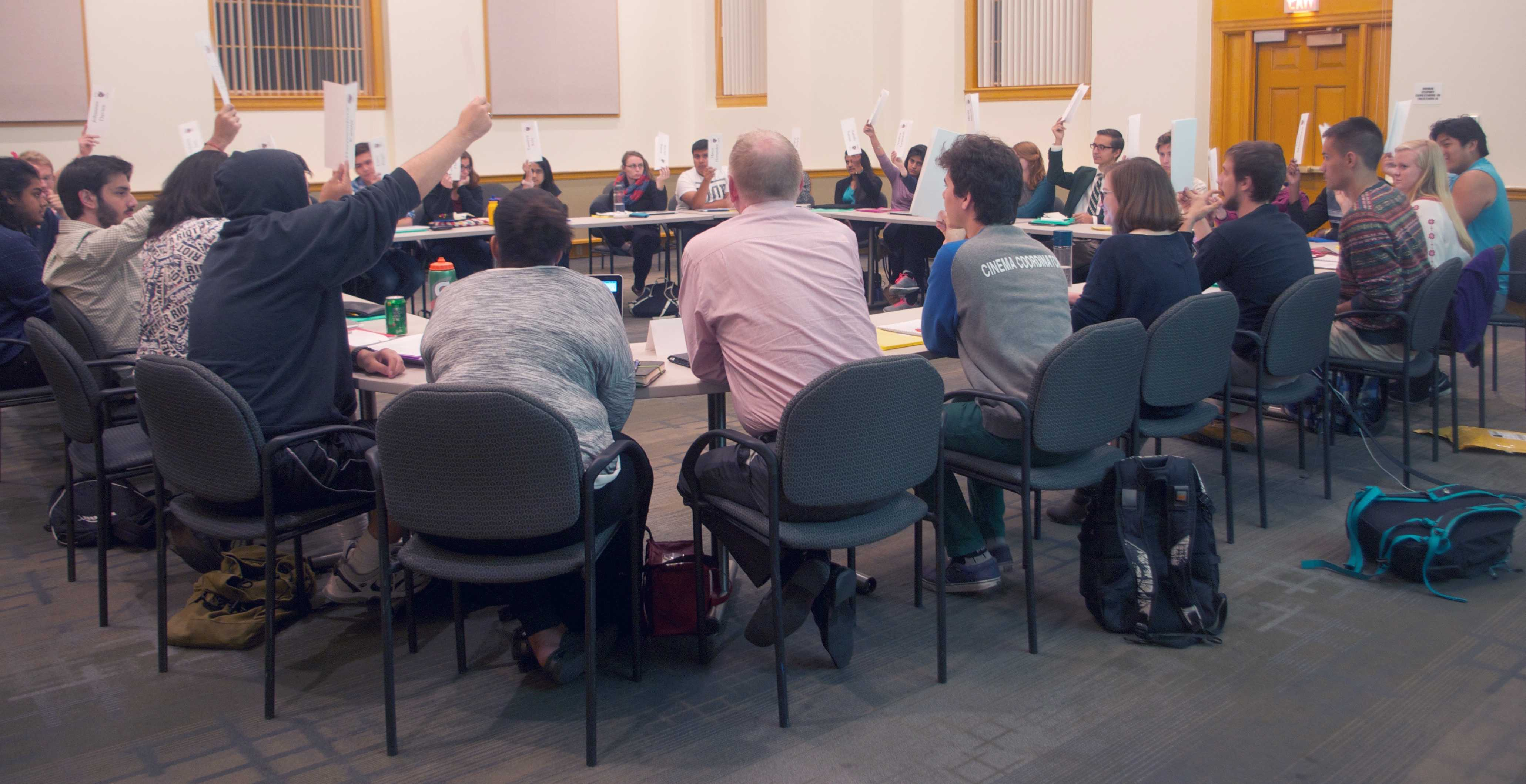 Pictured: MCSG Legislative Body voting during their weekly Tuesday meetings in Weyerhaeuser boardroom. Meetings are open to the public. Photo by Maddie Jaffe '17.