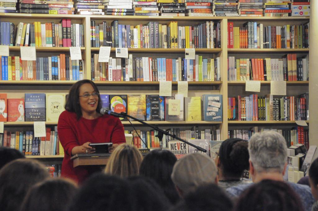Professor Dutchess Harris read from her book *Black Lives Matter* Monday evening at a standing-room only Common Good Books. The book has earned Harris this year's Minnesota Association of Black Lawyers' Profile in Courage award, and is set to be taught in Minneapolis Public Schools. *Photo by Maya Rait '18*