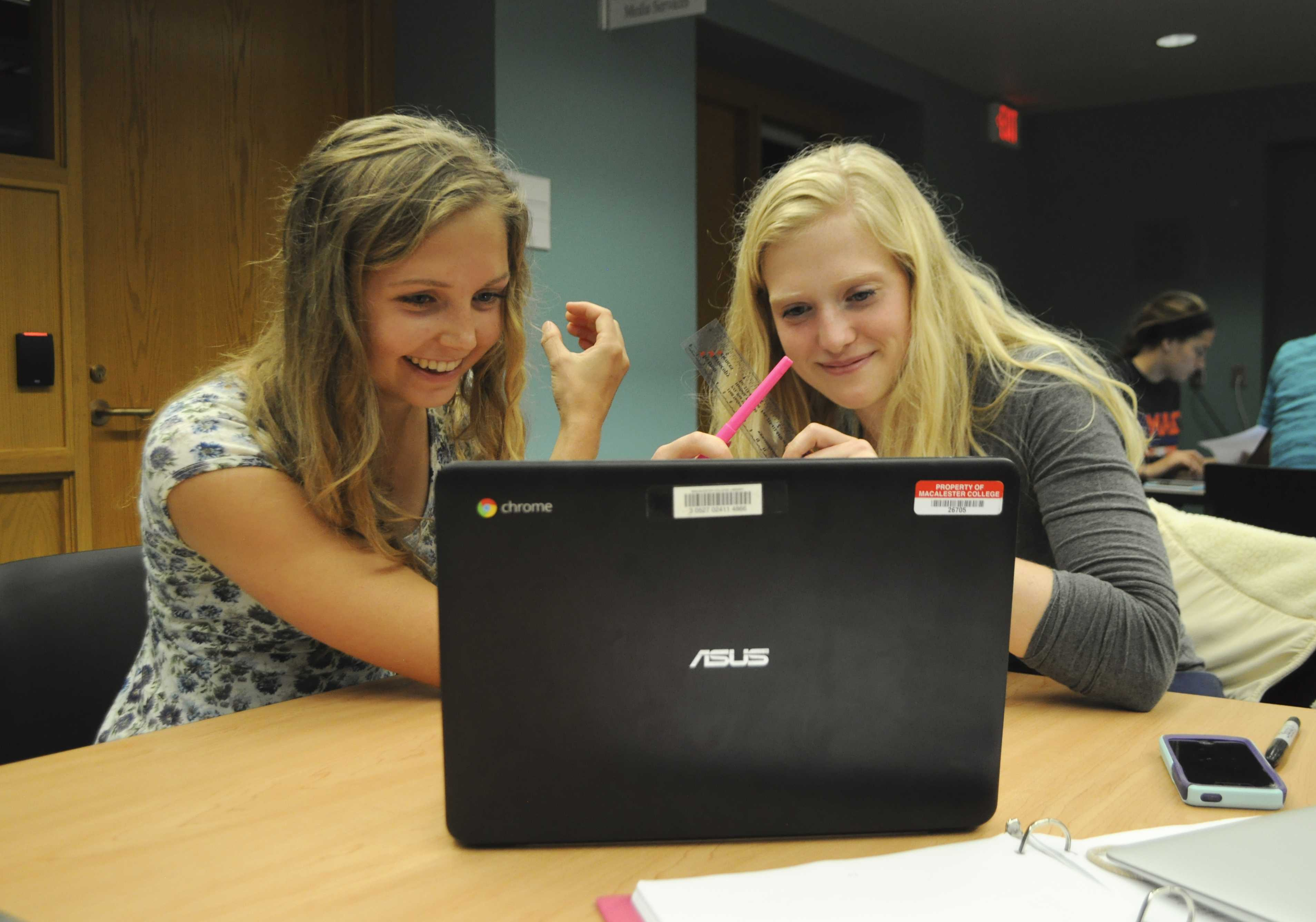 Lea Davidson '18 and Rosie Cobb '18 use of the library's new Chromebooks. 15 new Chromebooks were added to the library this year as a cost saving and accessibility mechanism. Photo by Maya Rait '18.