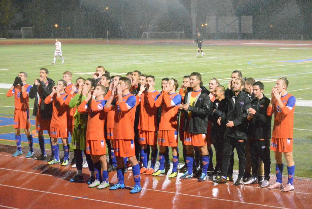 The men's soccer team led an enthusiatic rendition of