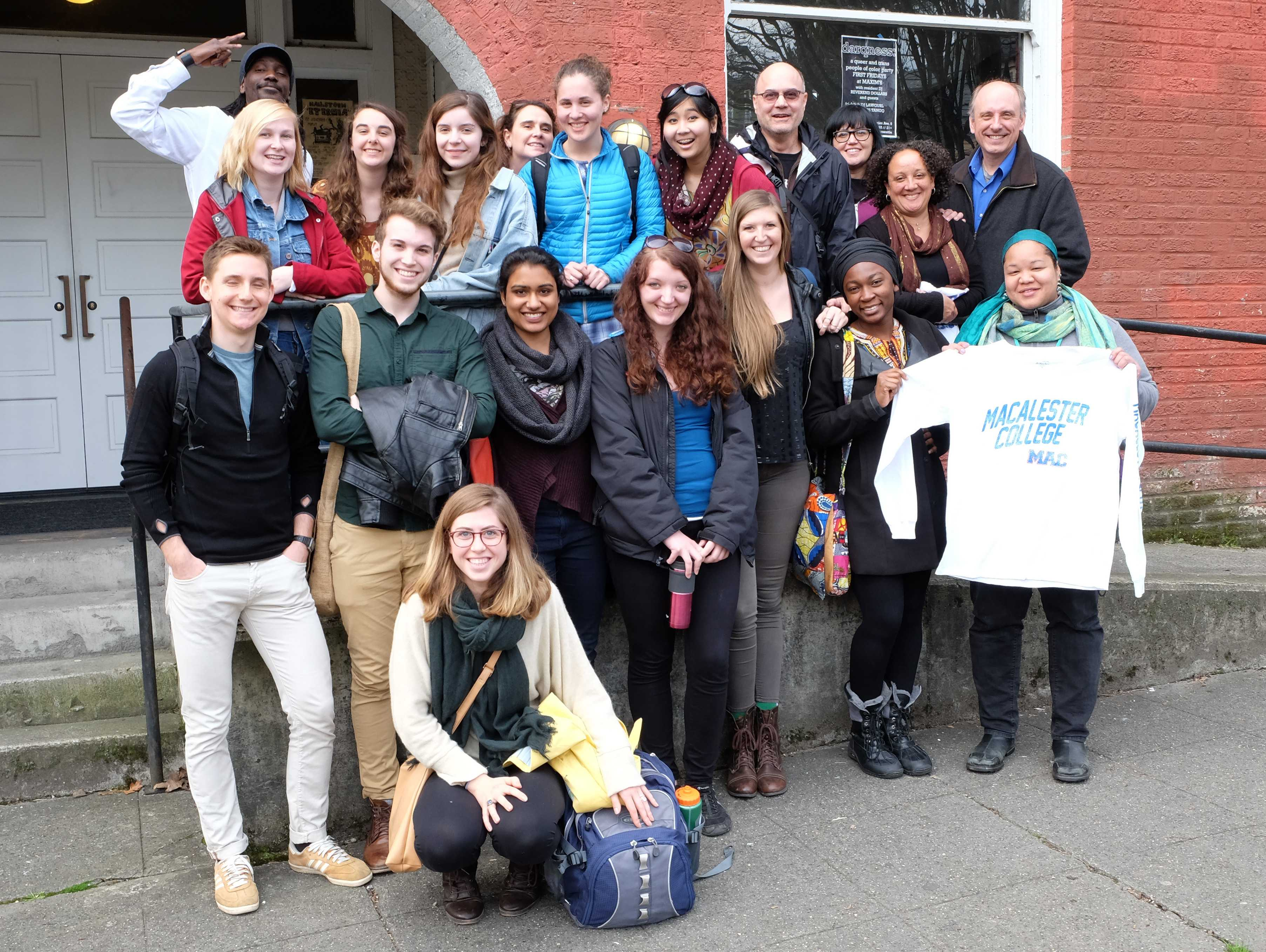 The cohort of Macalester students from the Engaging in the Twin Cities and Seattle course pose together in Seattle during their spring break trip.  The students met alumni in the city and discussed topics pertaining to urban issues. *Photo courtesy of Program Specialist Katie Pratt from the Institute for Global Citizenship.*