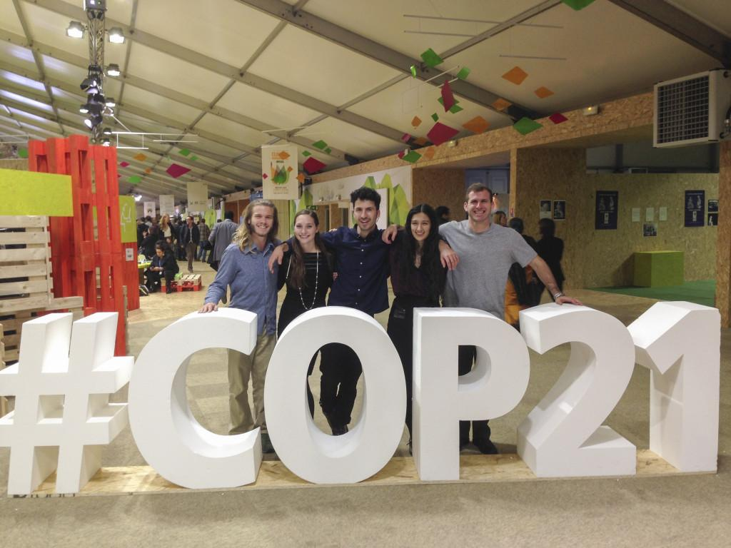 "Members of professor Roopali Phadke's ""Climate Talks: Dispatches from Paris"" class at the COP21 climate conference in Paris this week. The students have been observing press conferences and plenary sessions and interviewing leaders and delegates."