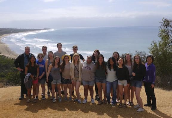 The 19-student Australia class poses on the Great Ocean Road. Photo courtesy of Erik Wiertelak.