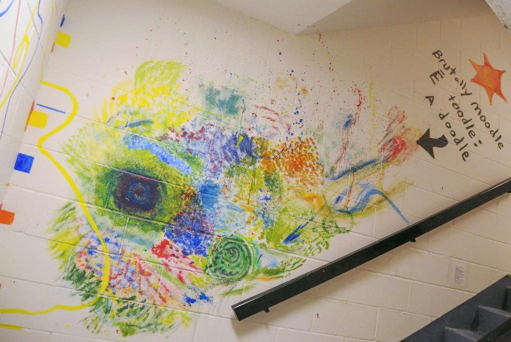 Paintings, poems and collages appeared in the west Dupre stairwell on Monday, Jan. 25. The mural, which was appluaded by some and criticized by others on Facebook, was the focus of several emails from Residential Life and a student-led petition. Photo by Maya Rait.