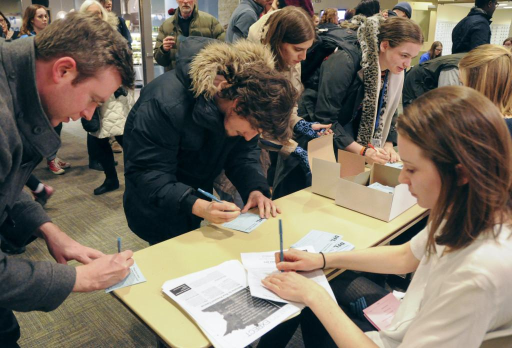 Students and community members gather in Macalester's Campus Center to caucus, campaign and cast their votes for their preferred democratic presidential nominee. Photo by Maya Rait '18.