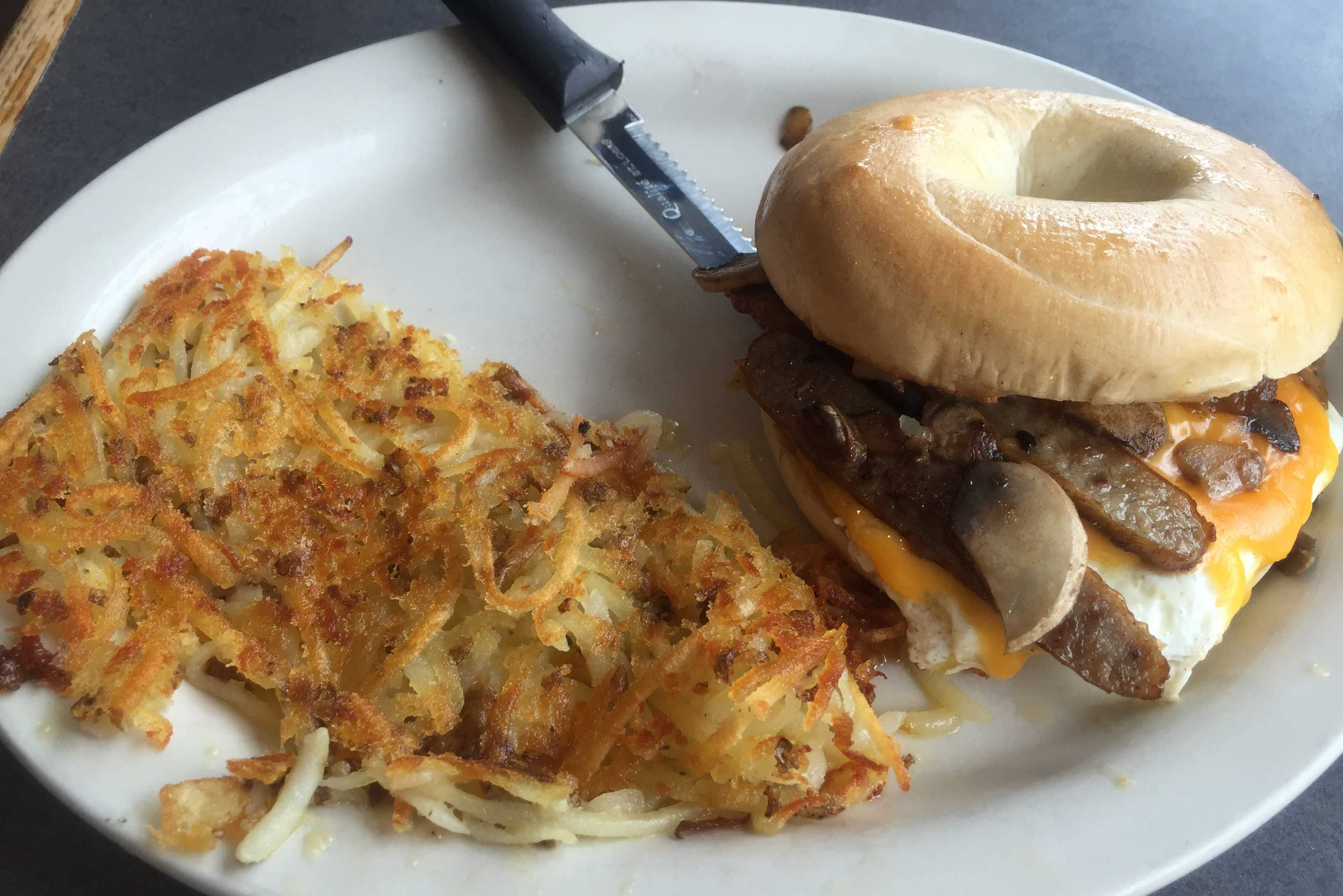 The Neighborhood Café breakfast sandwich with American cheese and sausage on a bagel. Photo by Joe Klein '16.