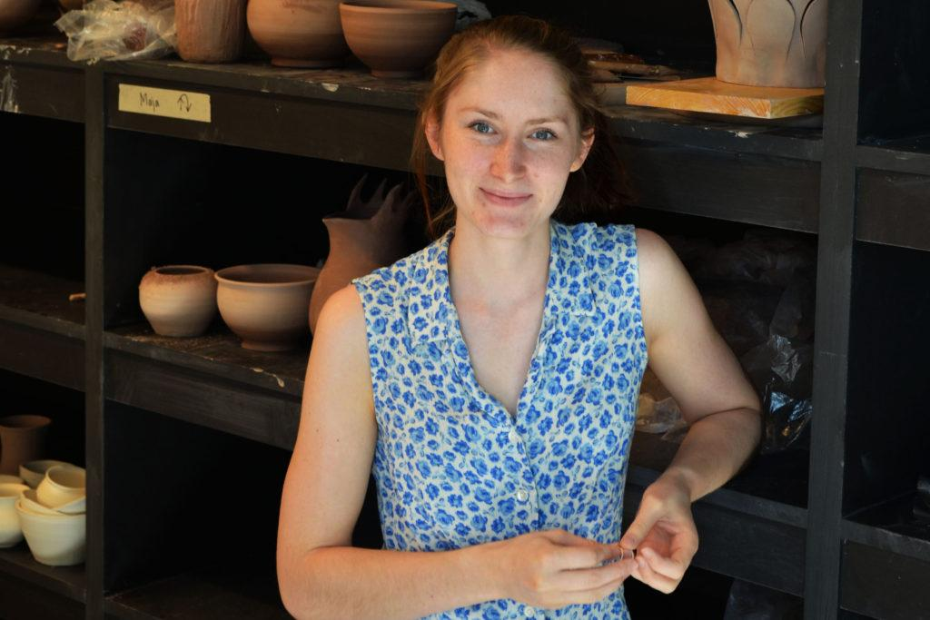 Maja Bendtsen '17 poses in front of her pottery. Photo by Maddie Jaffe '17.