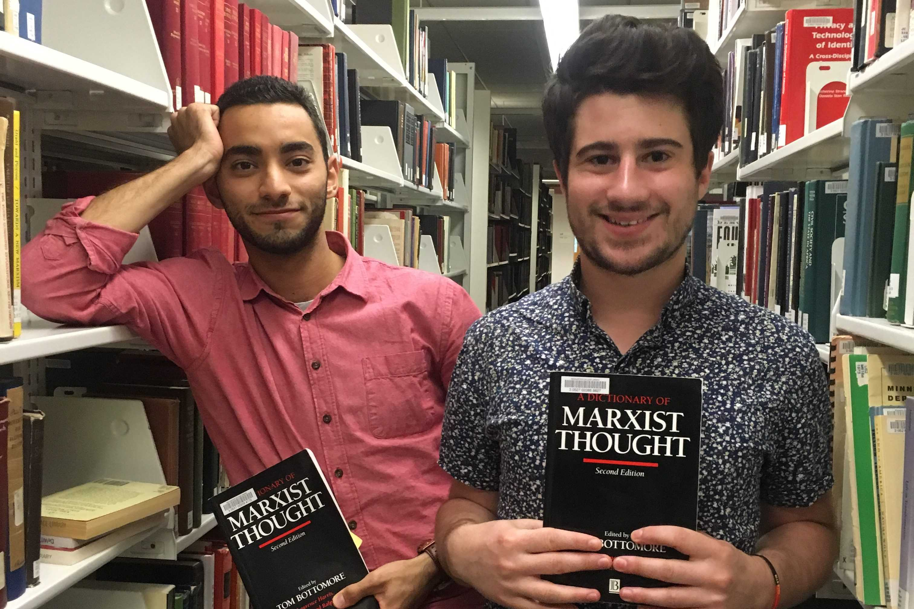 Jacob Bessen '17 and Muath Ibaid '17 enjoy light reading in the library. Photo by Kate Rhodes '17.