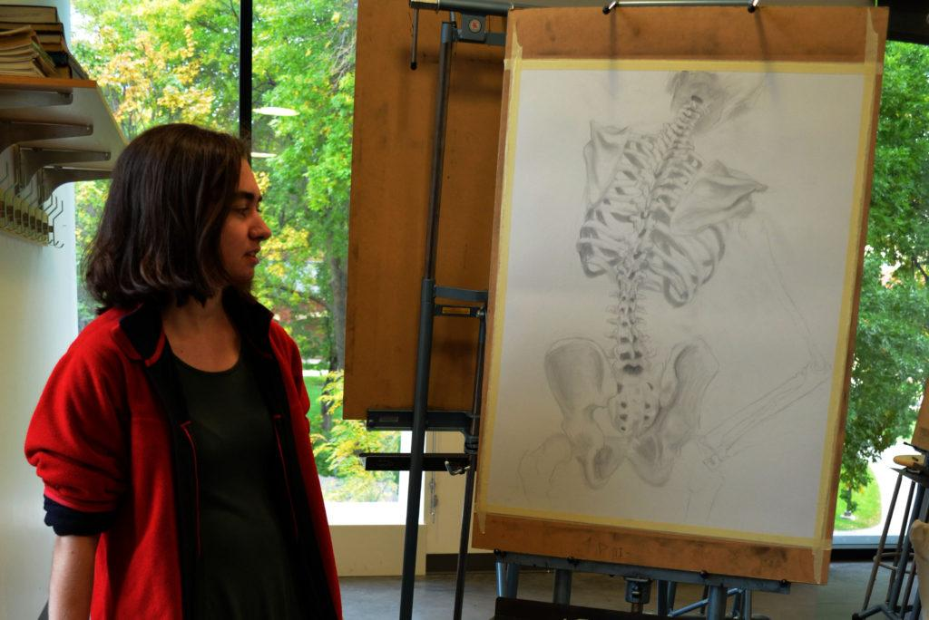 Rochelle+Peterson+%E2%80%9917+shows+off+one+of+her+realistic+sketches.+Photo+by+Maddie+Jaffe+%E2%80%9917.