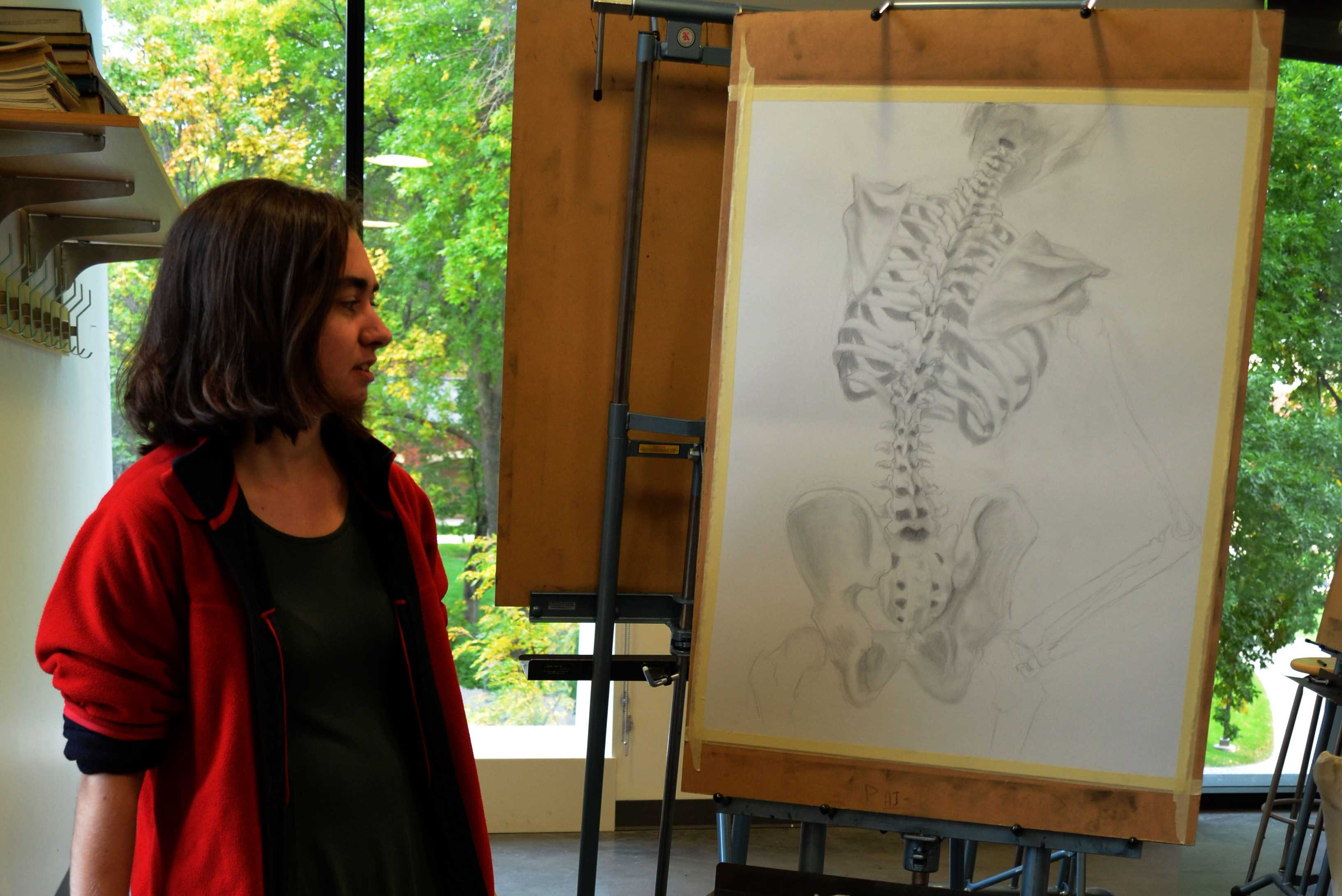 Rochelle Peterson '17 shows off one of her realistic sketches. Photo by Maddie Jaffe '17.