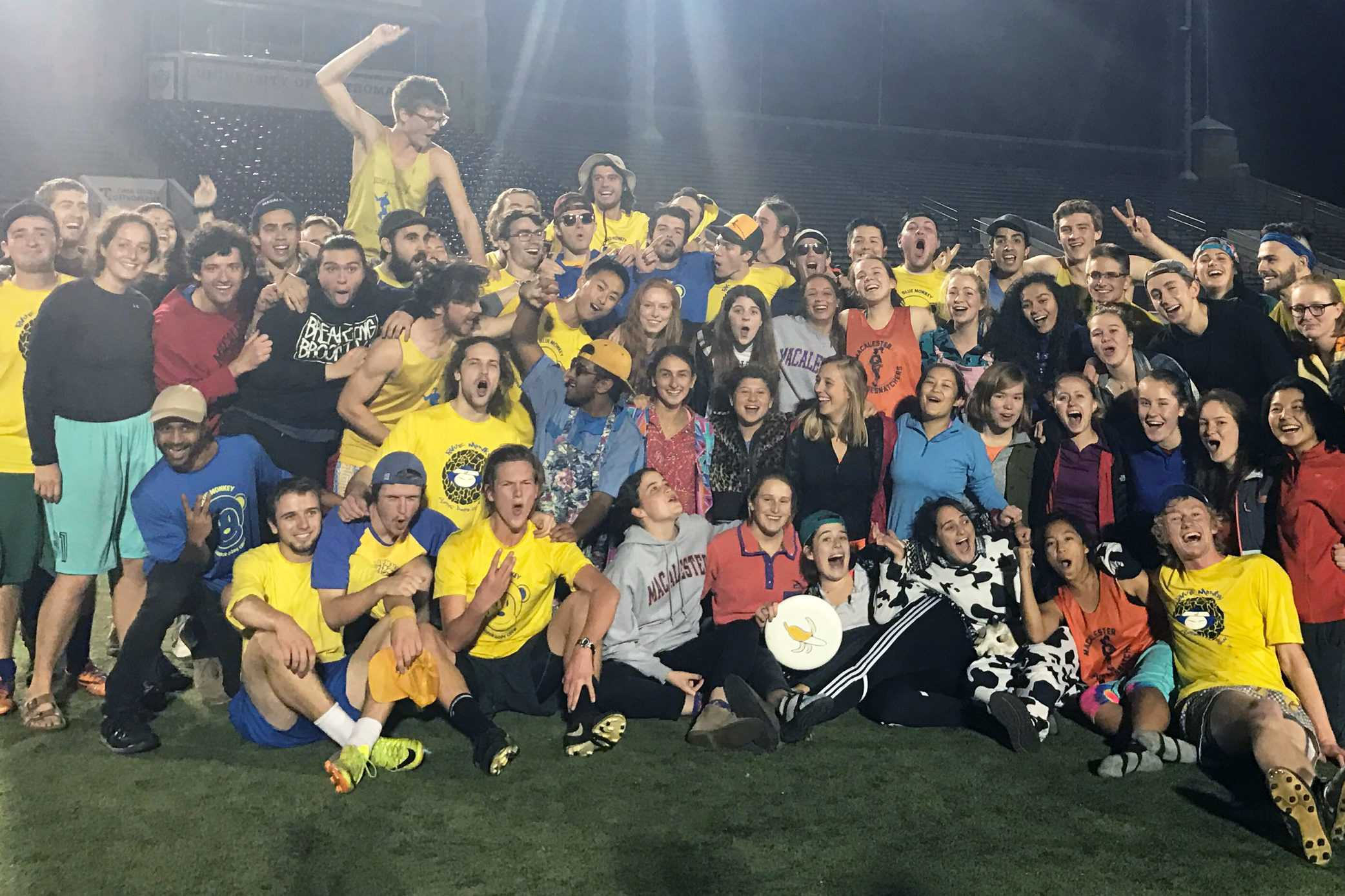 The Men's and Women's Club Frisbee teams come together to celebrate after sweeping their Mac-Tommie matches. Photo courtesy of Eloise Terry '17.