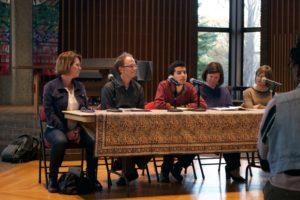Speakers contribute to a panel at the community discussion on Wednesday. Photo by Jen Katz '19