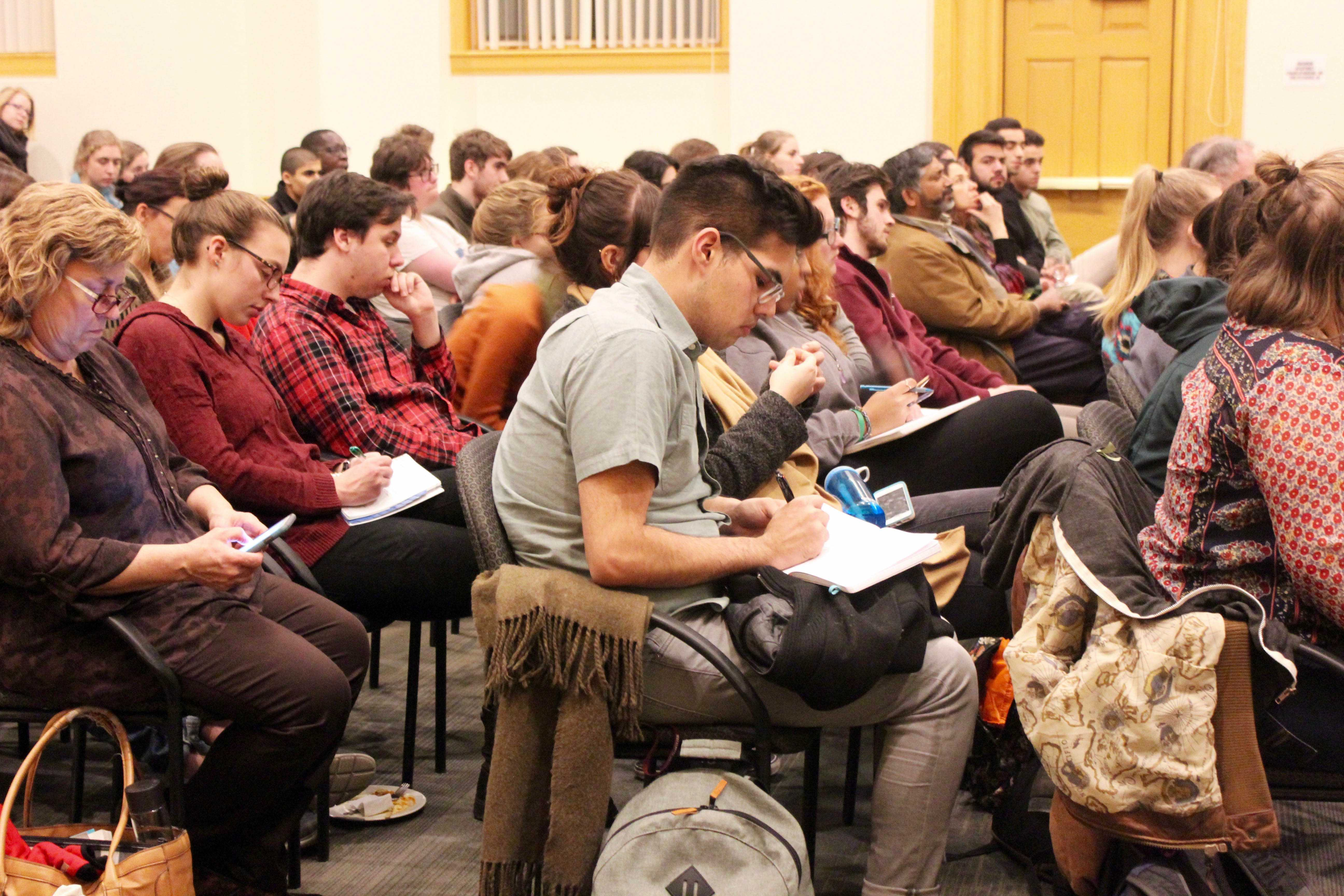 Students, faculty and community members gather in Weyerhaeuser Boardroom on  Thursday, Feb. 16 to hear a panel discussion on national and international Islamophobia. Photo by Emma Carray '20.