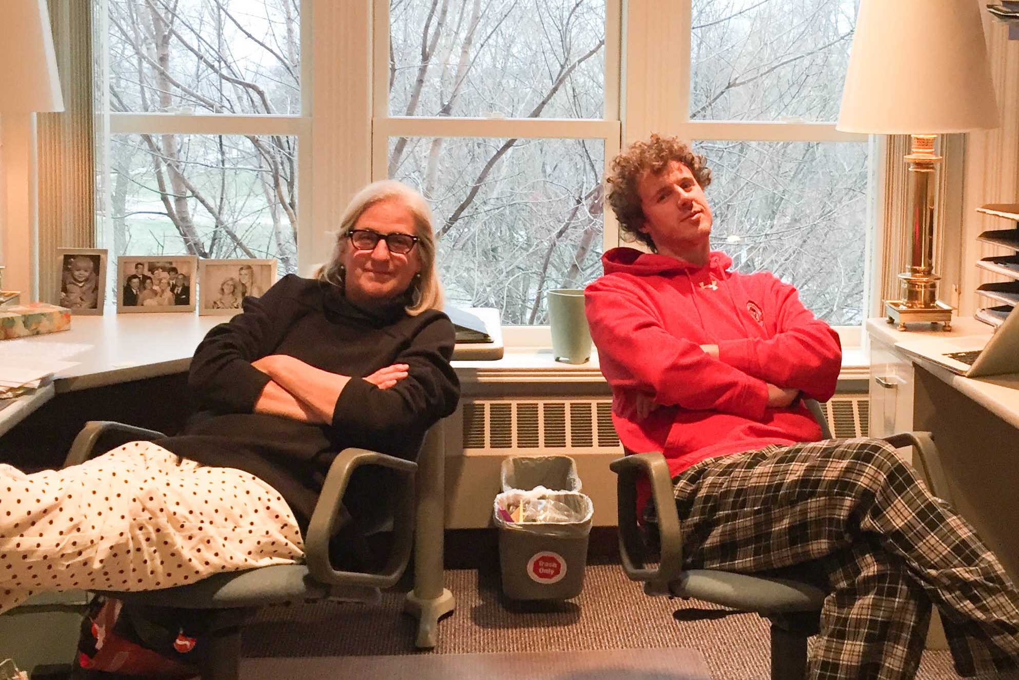 Jan Beebe and Hank Hietala '17 relax in the English office on pajama day. Photo courtesy of Jane Beebe.