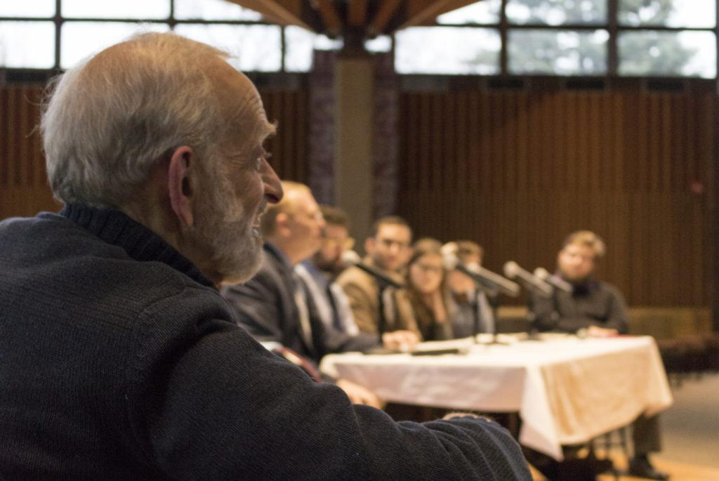 """Rabbi Barry Cytron listens to a panel of his former students on """"the Future of Jewish Studies in America"""" in Weyerhauser Chapel on April 3. Cytron is retiring after 28 years at Macalester College. Photo by Maddie Jaffe '17."""