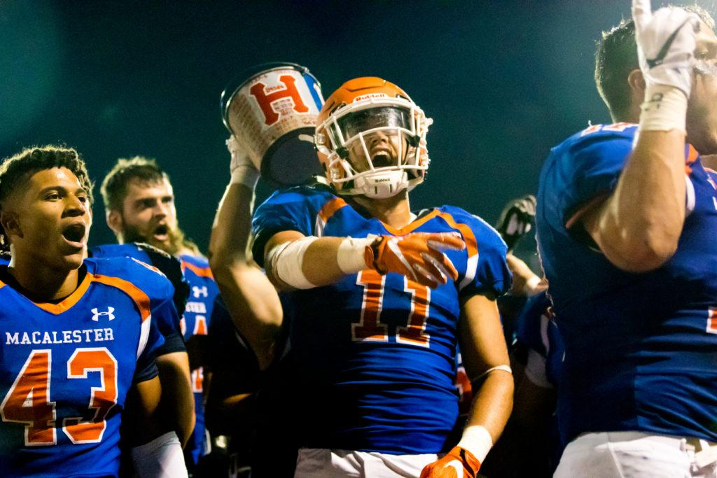Macalester+Scots+football+players+celebrate+their+win+against+the+Hameline+Pipers.+This+is+the+first+time+the+Scots+have+held+both+the+Book+of+Knowledge+and+Paint+Bucket.+Photo+courtesy+of+Jason+Bartz%2C+670photography.
