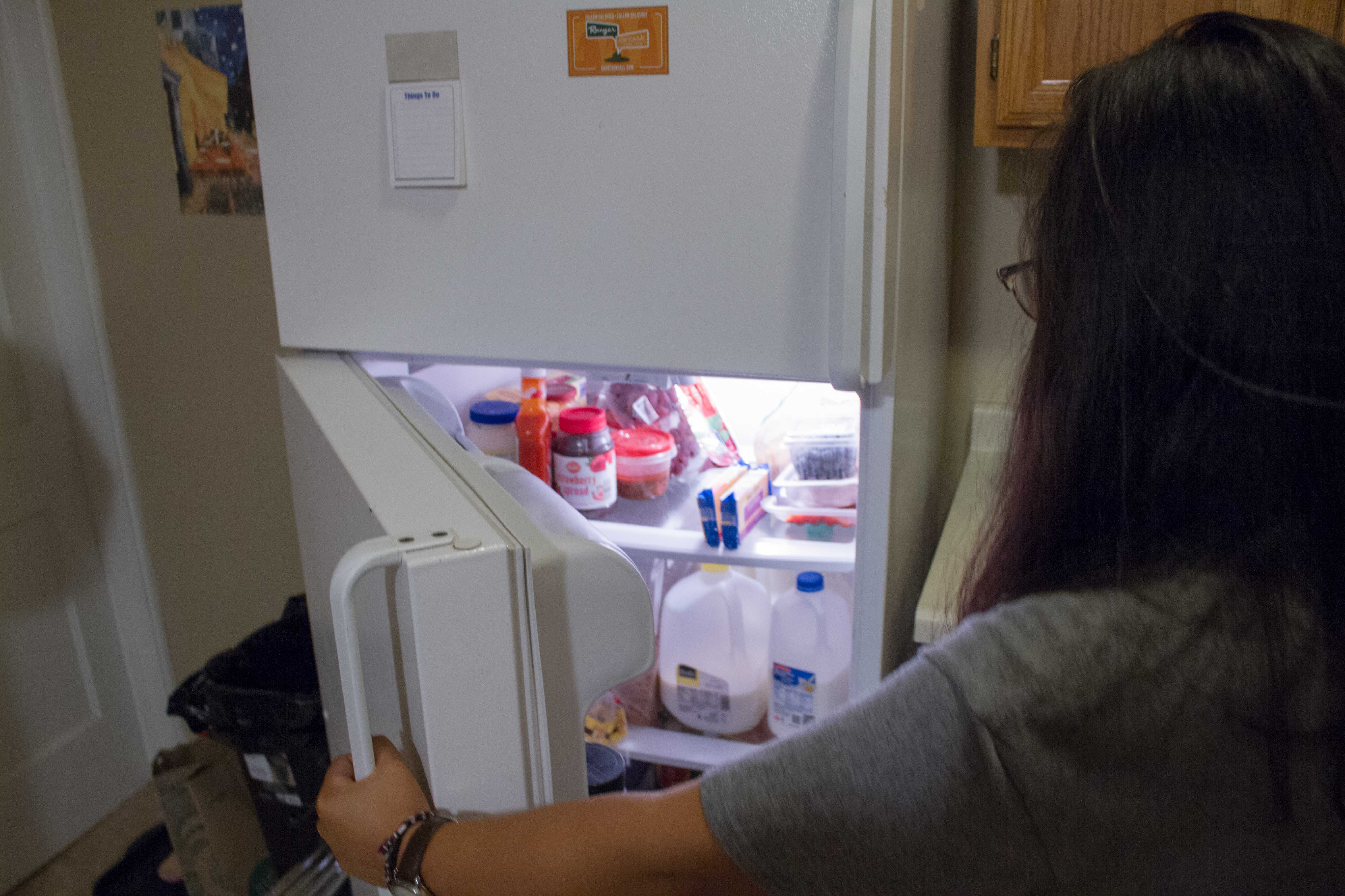 Alta Connors rummaging through her fridge. Photo by of Noah Zwiefel '19