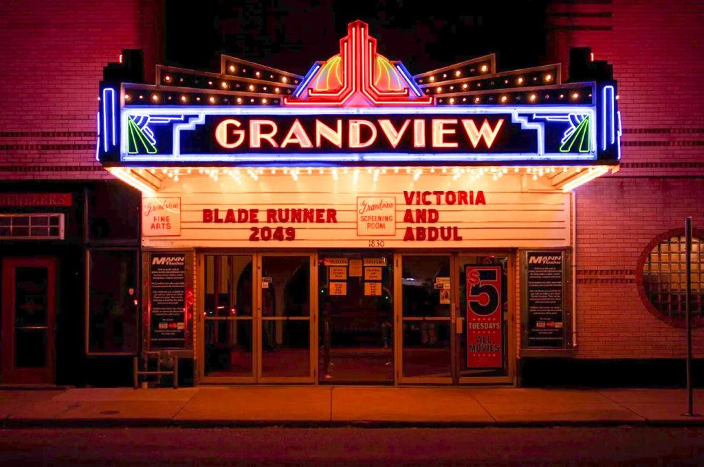 The front entrance of the Grandview theater on 1830 Grand Ave. displaying the movies playing. Photo by Kori Suzuki '21.