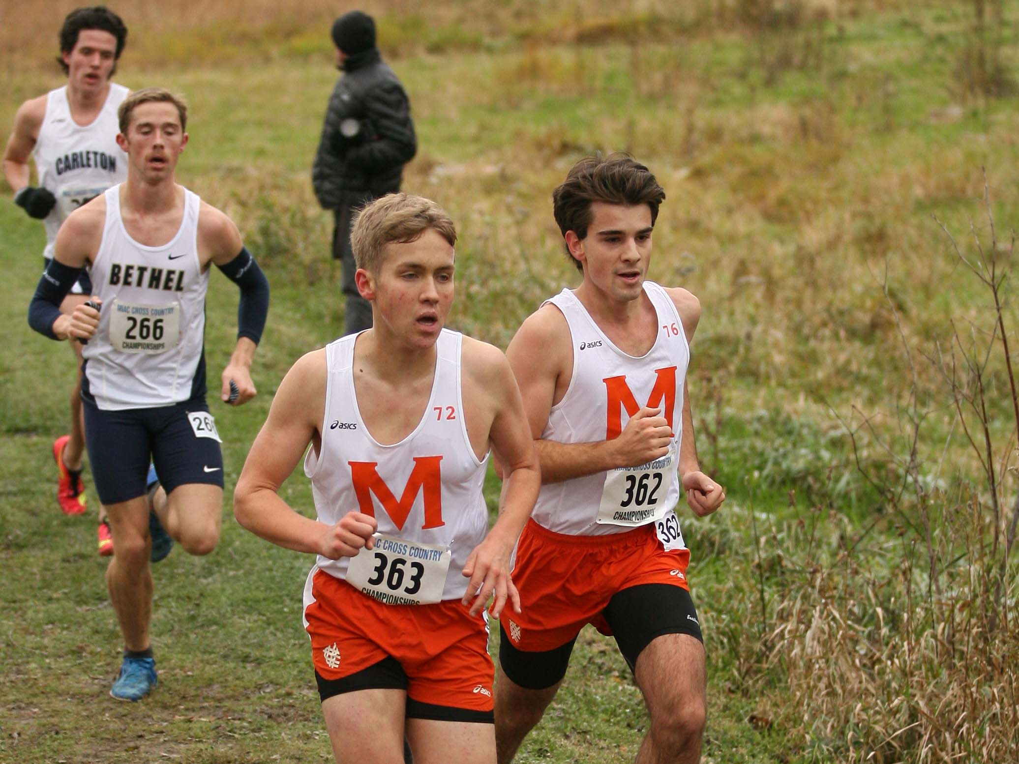 Adrian Johnson '21 and Peter Jarka-Sellers '20 run in the MIAC Championship. Both runners scored for Macalester, with a 50th place finish for Jarka-Sellers and a 63rd place finish for Johnson. Macalester finished seventh out of 11 teams. Photo courtesy of Bill Lepak.
