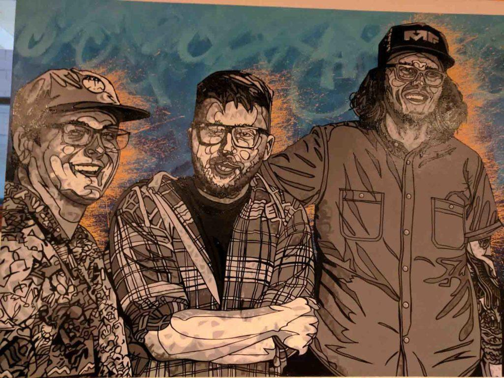 A painting of the three original 12welve Eyes brewers Josh Oestreich, Dalton Buchta and Elliot Grosse. The three men have known each other since their youth in suburban St. Paul. by Henry Nieberg '19.