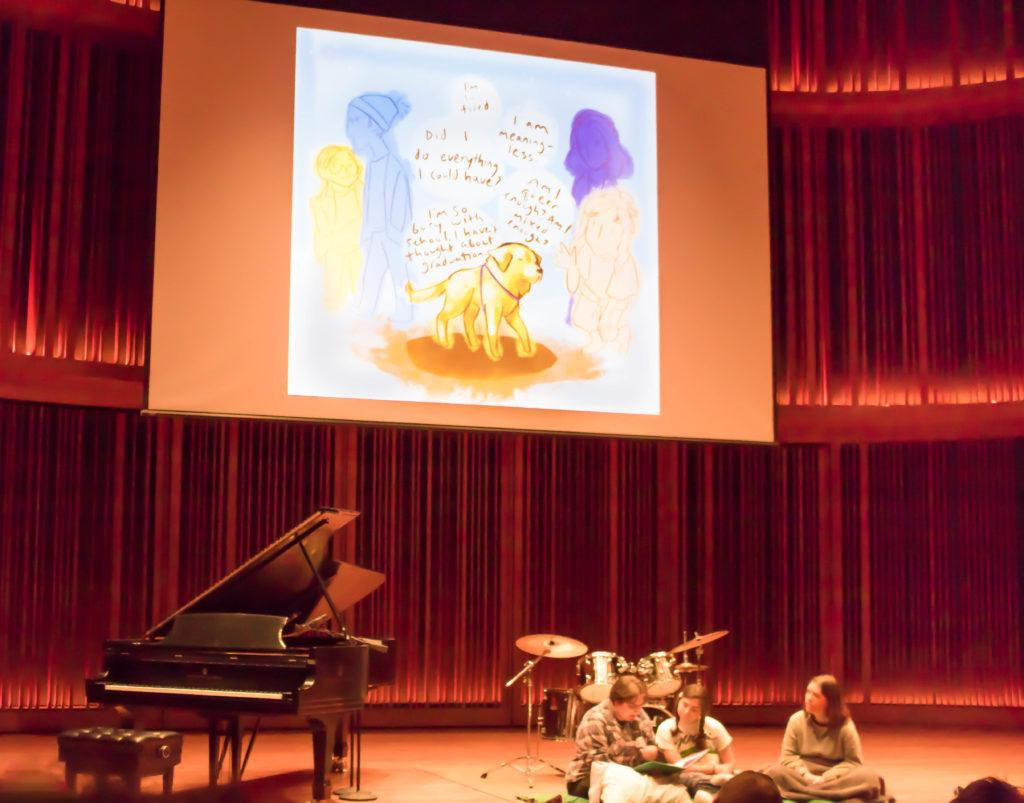 """'Winnie and the People' deliver their creative performance in Mairs Concert Hall on Saturday, Feb. 17. The group was crowned winner of Macalester's first annual MacroBurst competition for their """"Bedtime Story for College Students."""" Photo by Carmen Bustamante '18."""