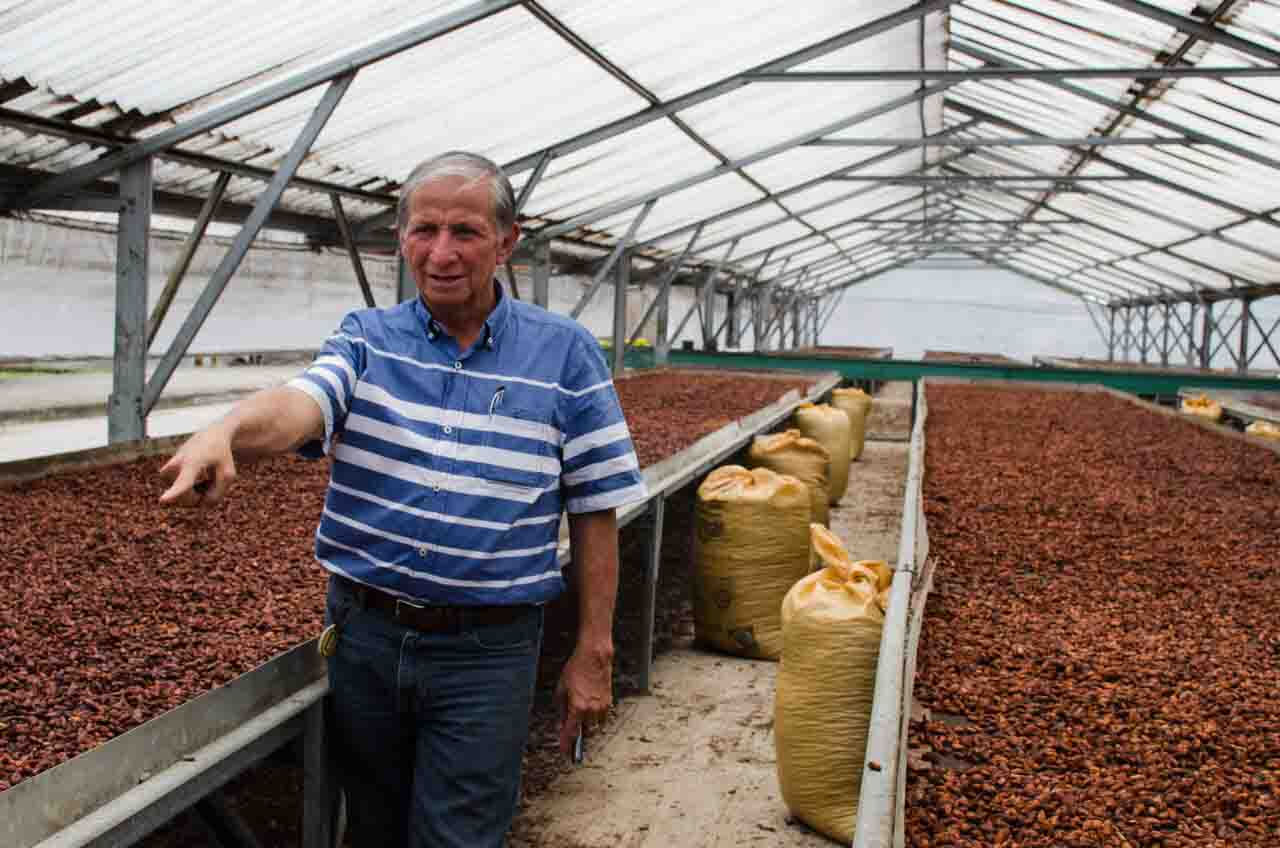Berto Zambrano, manager of the Fortaleza del Valle cocoa cooperative in Ecuador, shows off drying cacao beans. Photo by Molly Flerlage '18.