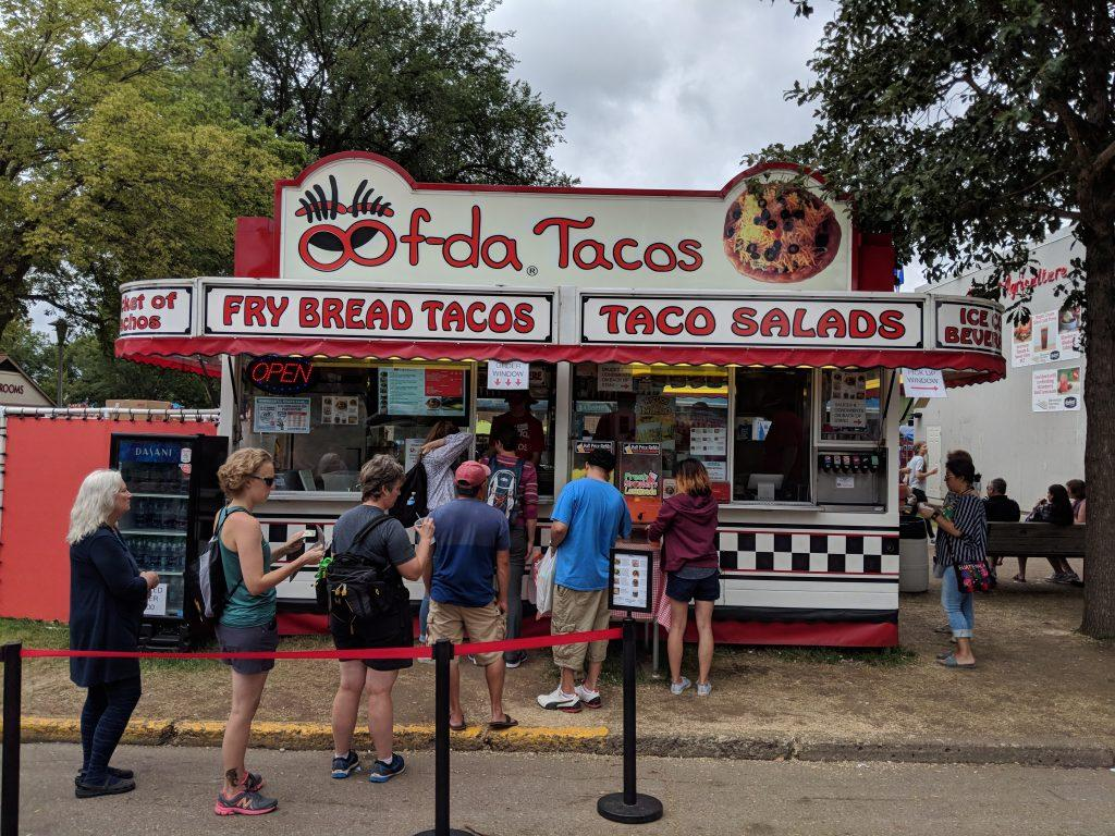 "One of the many intriguing and unique stands offered at the Minnesota State Fair.  ""Oofda"" Tacos offers a bucket of nachos, fry bread tacos, and taco salads. Photo by Henry Nieberg '19."